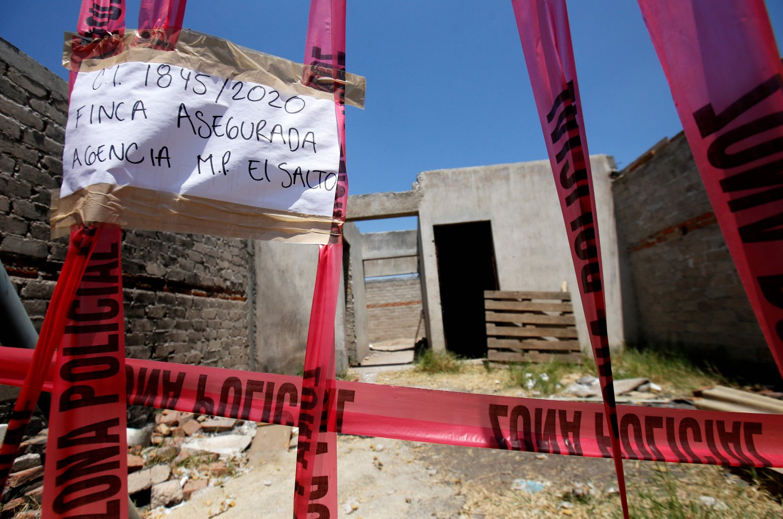 Picture of a taped-off unfinished construction at the farm where the remains of at least 25 people were found buried in a clandestine mass grave in the municipality of El Salto, outside the western Mexican city of Guadalajara, in Jalisco State, May 10, 2020. (AFP Photo)