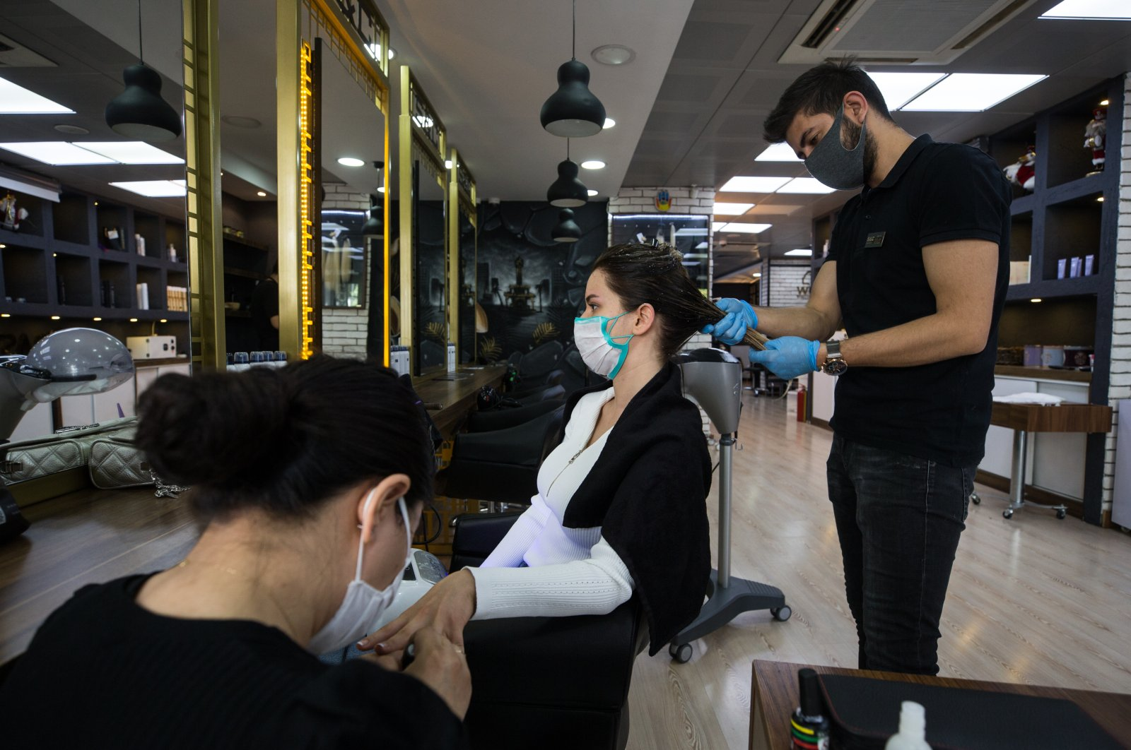 As part of the gradual normalization, barbershops and hairdressers resumed work on May 11, 2020 across Turkey. (AA Photo)
