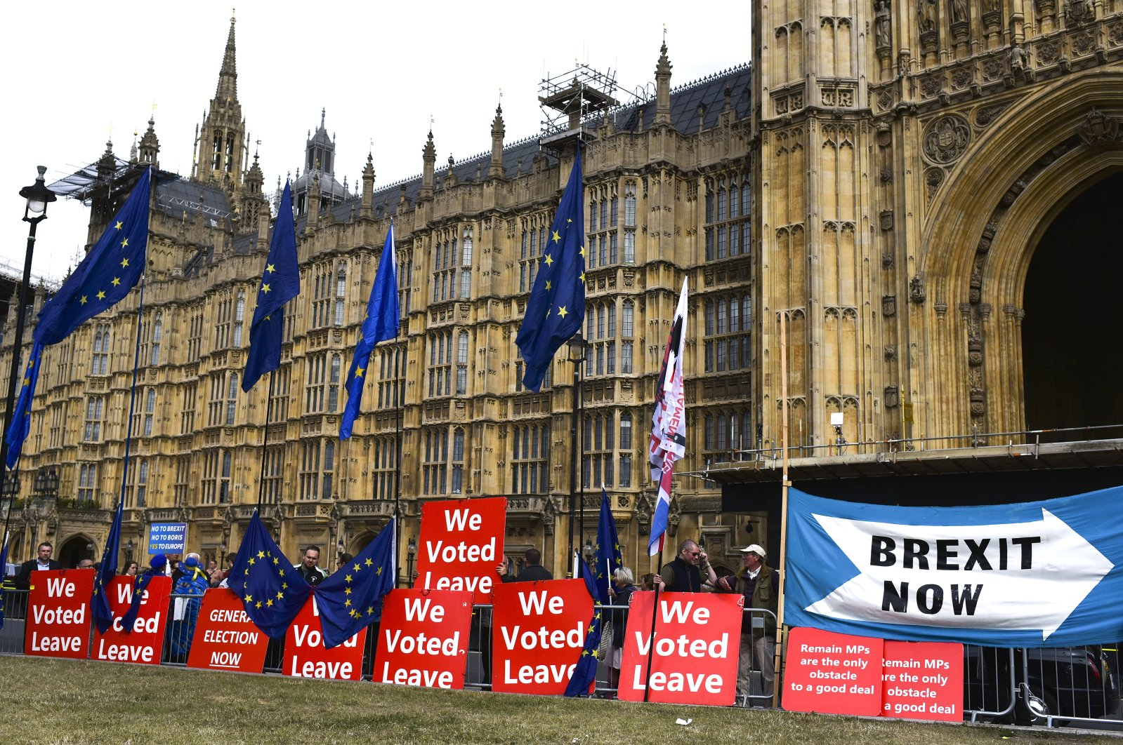 Pro Brexit placards and EU flags are pictured outside the Houses of Parliament, London, Sept. 5, 2019. (AP Photo)