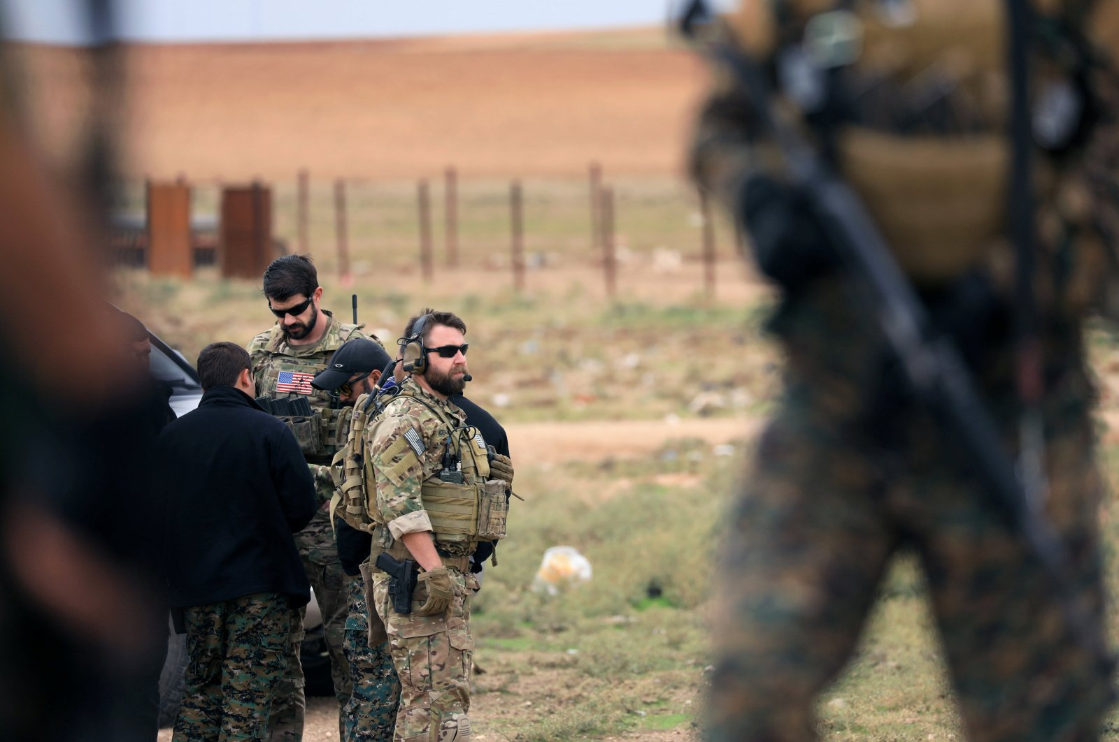 Members of the YPG and U.S. troops are seen during a patrol near the Turkish border in Syria's Hasakah province, Nov.4, 2018. (REUTERS)