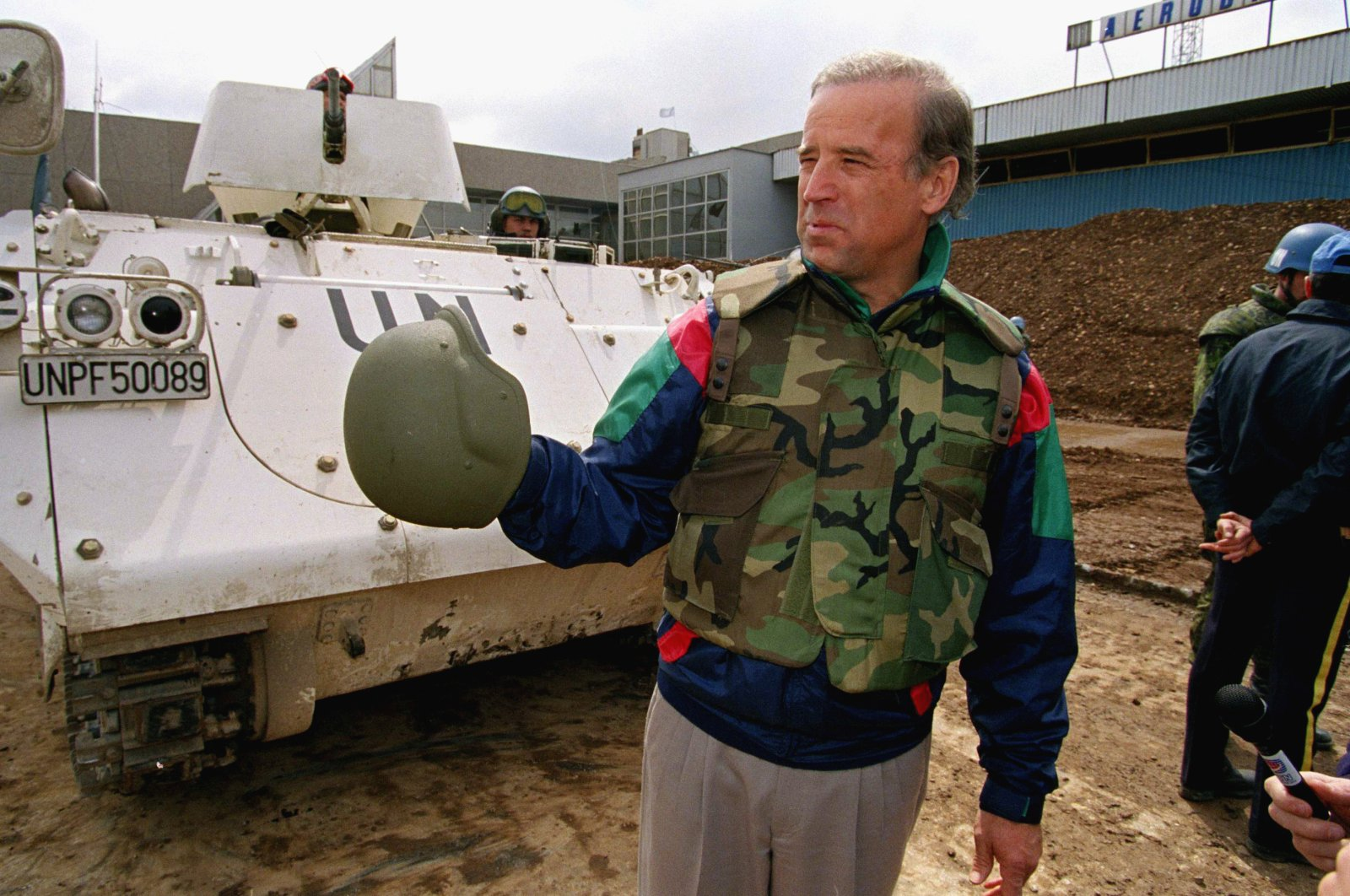 Sen. Joe Biden (D-Del.) stands in front of a Danish armored personnel carrier at the U.N.-controlled Sarajevo Airport, April 9, 1993, making a statement about his trip to the besieged Bosnian capital. (AP Photo)