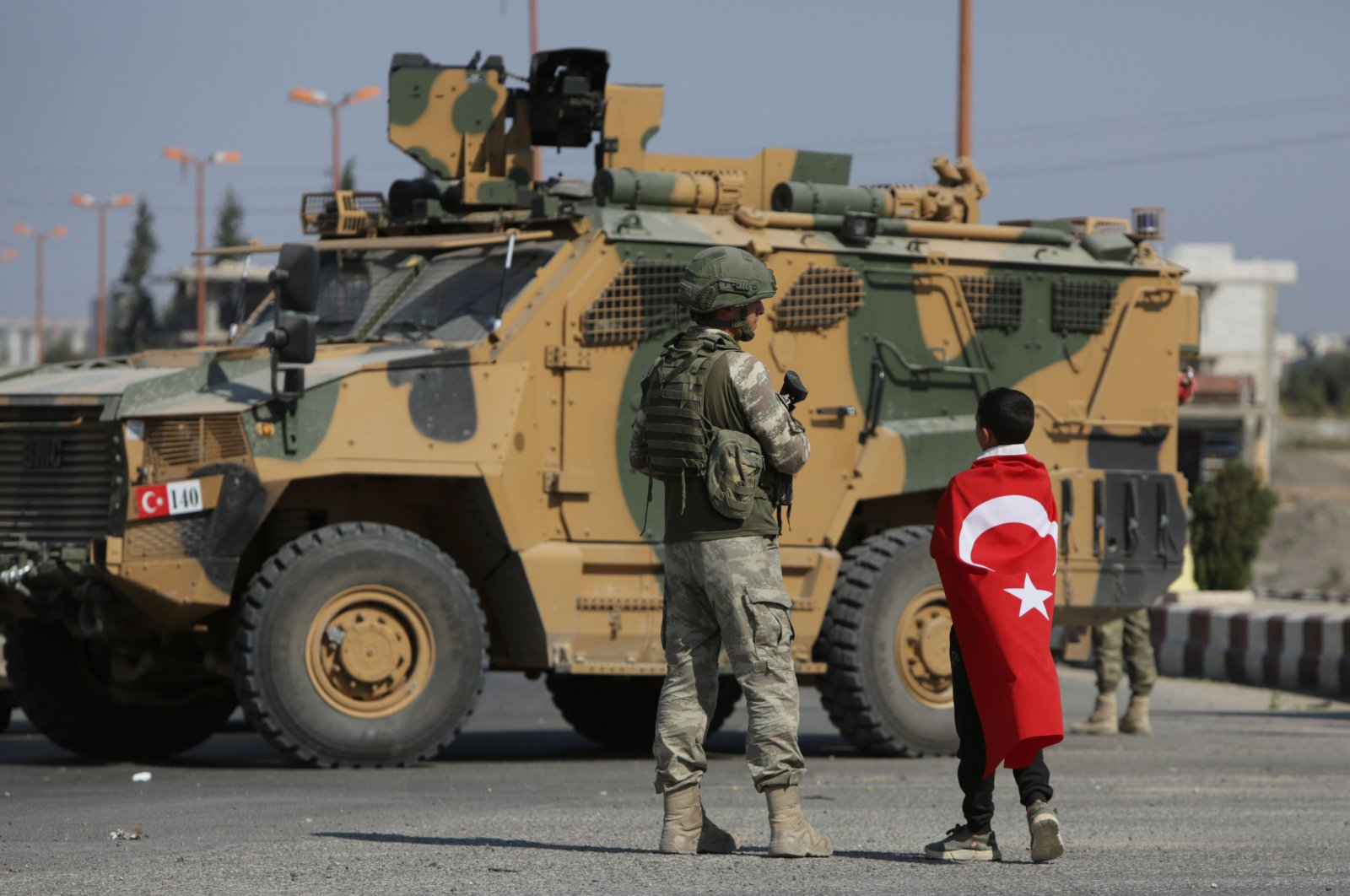 Turkish soldiers patrol the northern Syrian town of Tal Abyad, on the border between Syria and Turkey, Oct. 23, 2019. (AFP Photo)