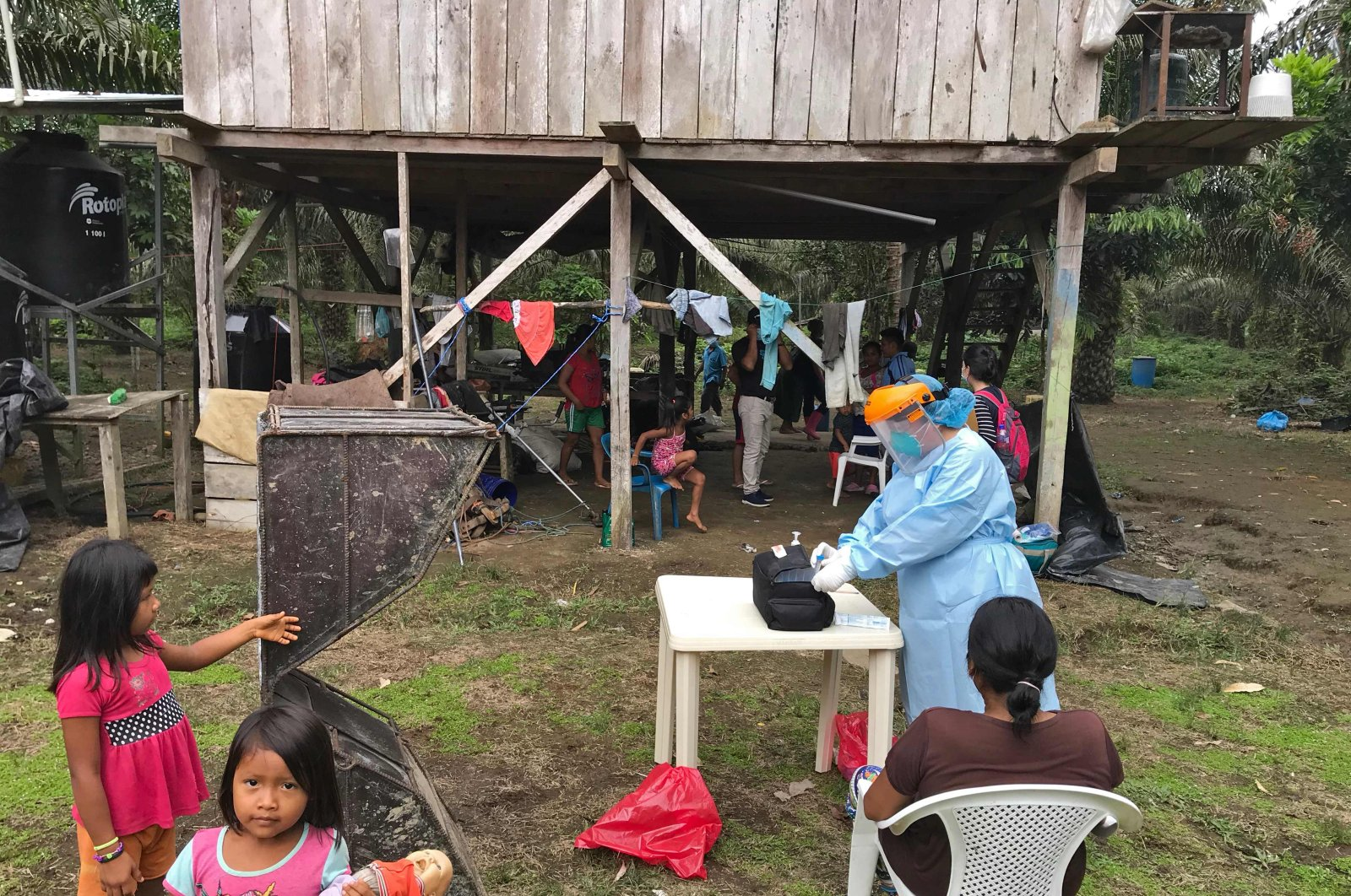 This handout photo released by the NGO Amazon Frontline & Alianza Ceibo shows Ecuador's Health Ministry personnel testing Siekopai nation members for COVID-19 in the community of San Pablo, Ecuador, April 29, 2020. (AFP Photo)
