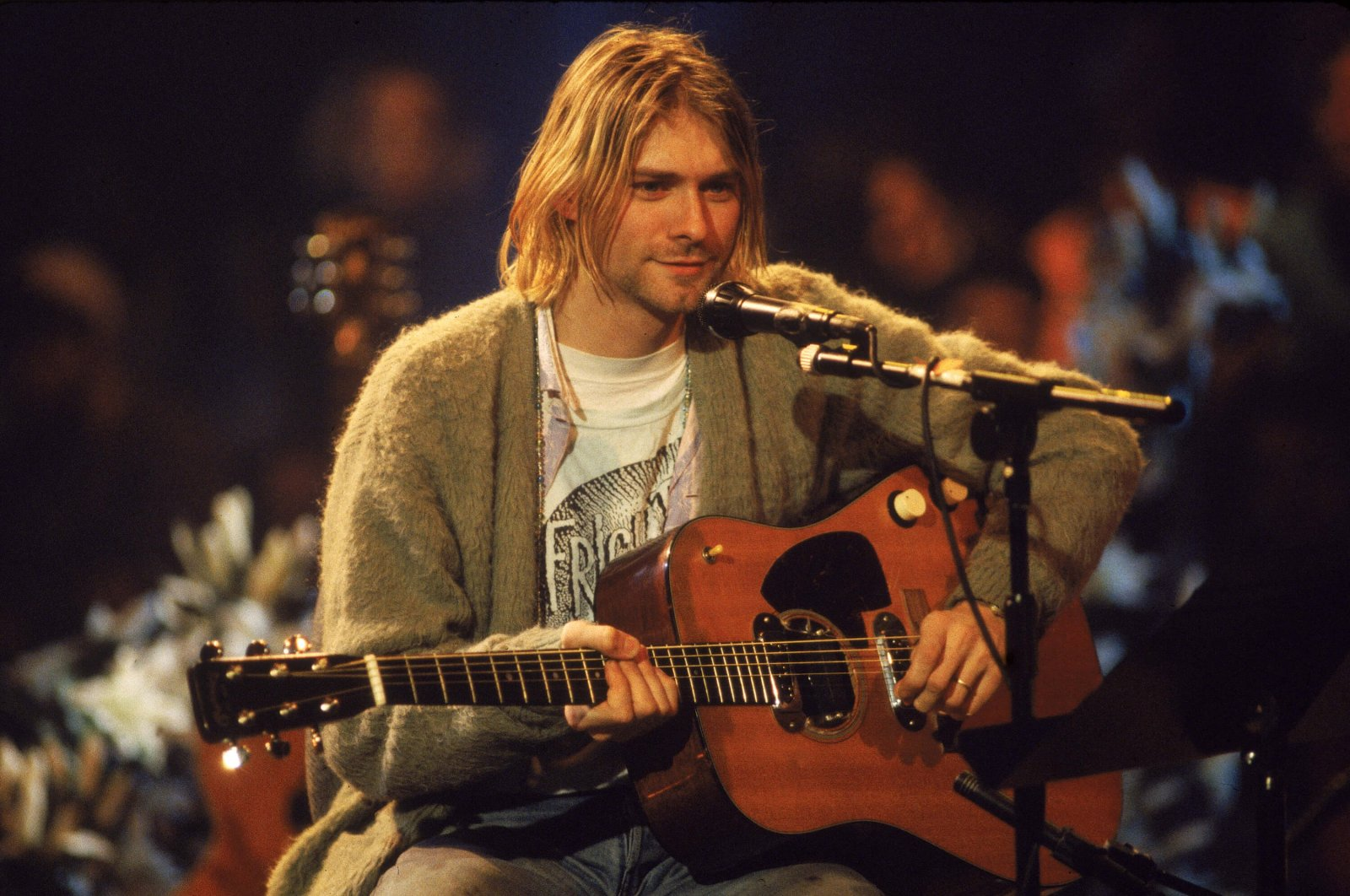 "Kurt Cobain performs with his olive-green cardigan, which sold for $334,000 at an auction in 2019, at ""MTV Unplugged"" in New York, Nov. 18, 1993. (Getty Images)"