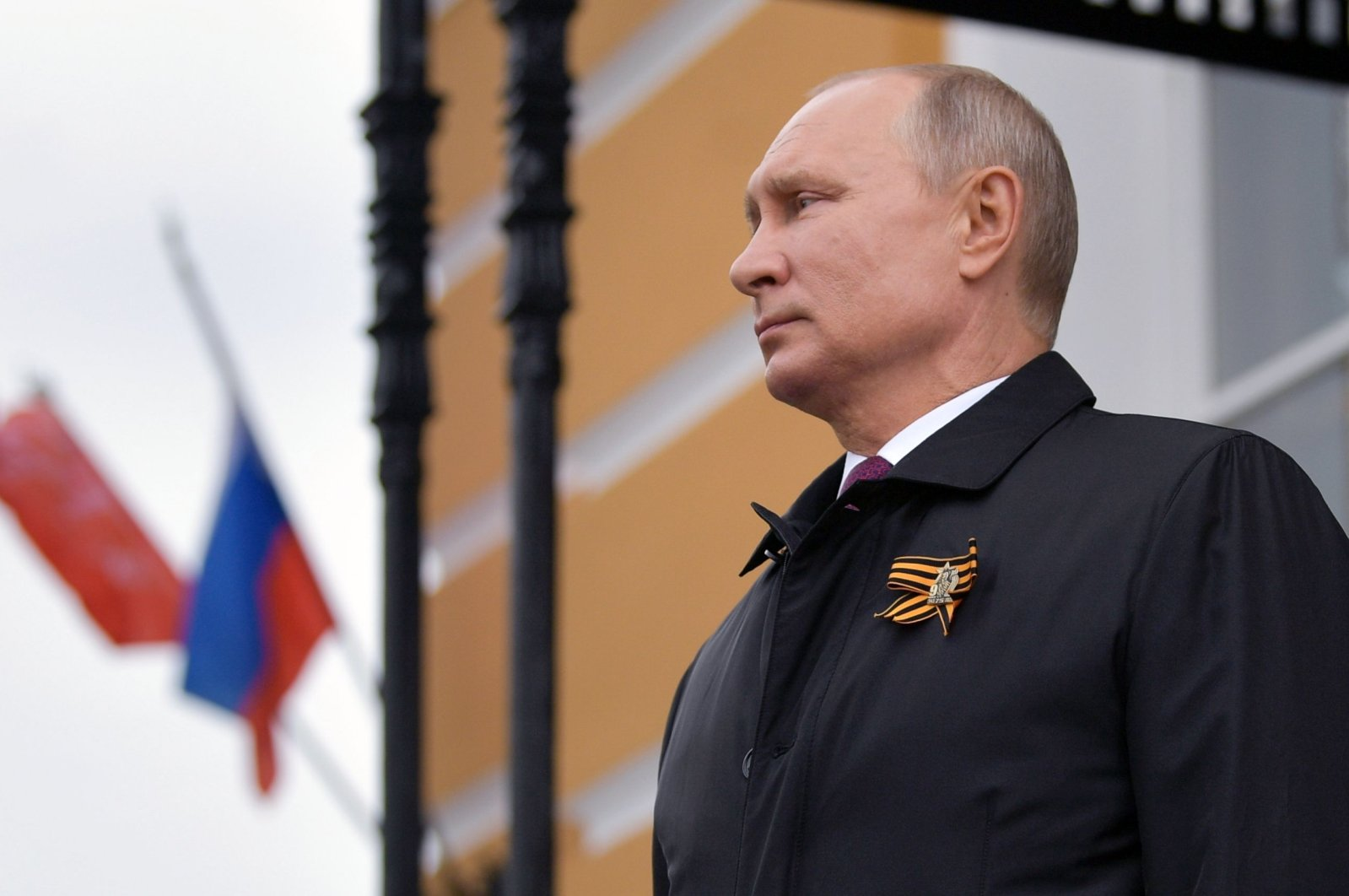 Russian President Vladimir Putin looks at military aircrafts flying over the Kremlin and Red Square to mark the 75th anniversary of the victory over Nazi Germany in World War Two, Moscow, May 9, 2020. (AFP Photo)
