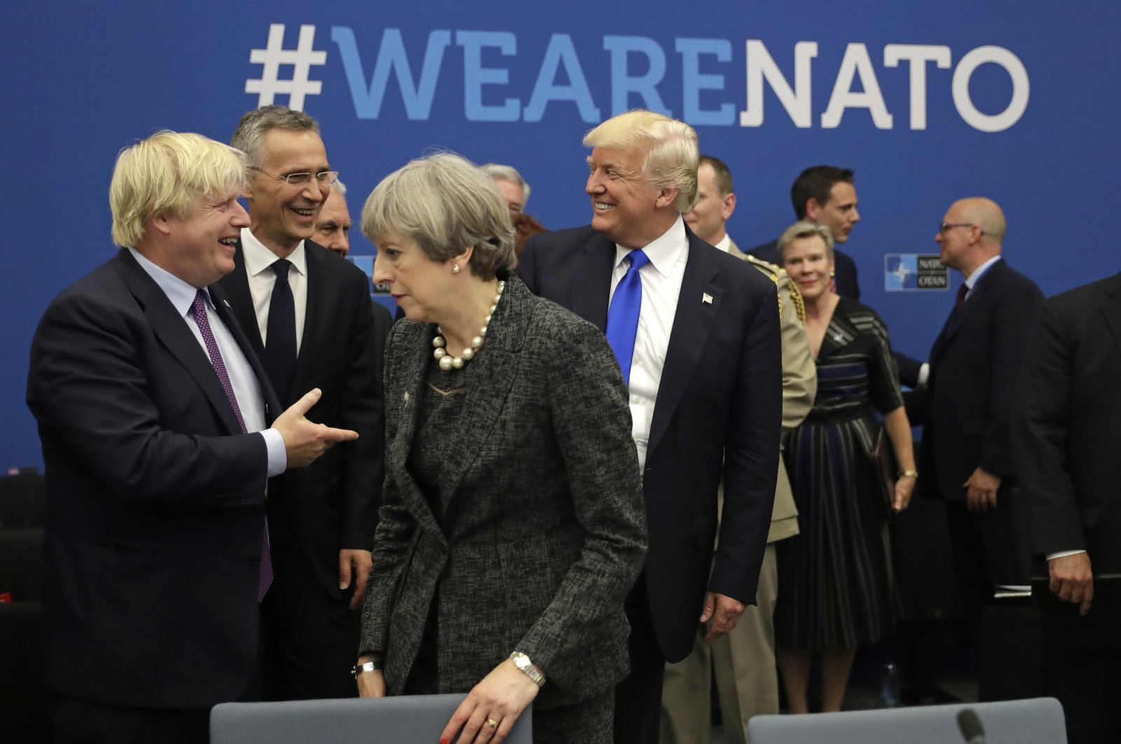 U.S. President Donald Trump jokes with Boris Johnson during a working dinner meeting at the NATO headquarters in May 25, 2017. (AP Photo)