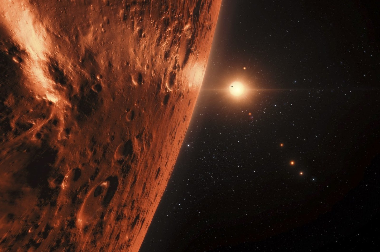 This handout artistís impression released by the European Southern Observatory on February 22, 2017 shows the view just above the surface of one of the planets in the TRAPPIST-1 system. (AFP Photo)
