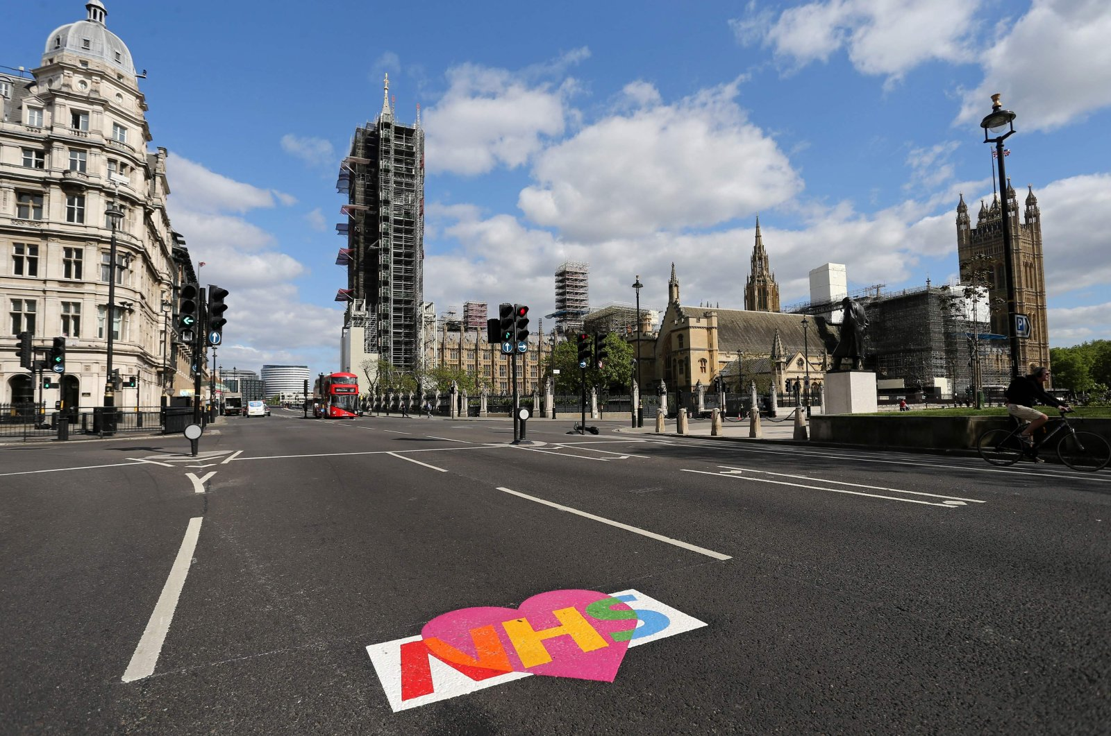 A logo of Britain's NHS (National Health Service) is pictured on an empty road near the Houses of Parliament in central London on May 11, 2020. (AFP Photo)