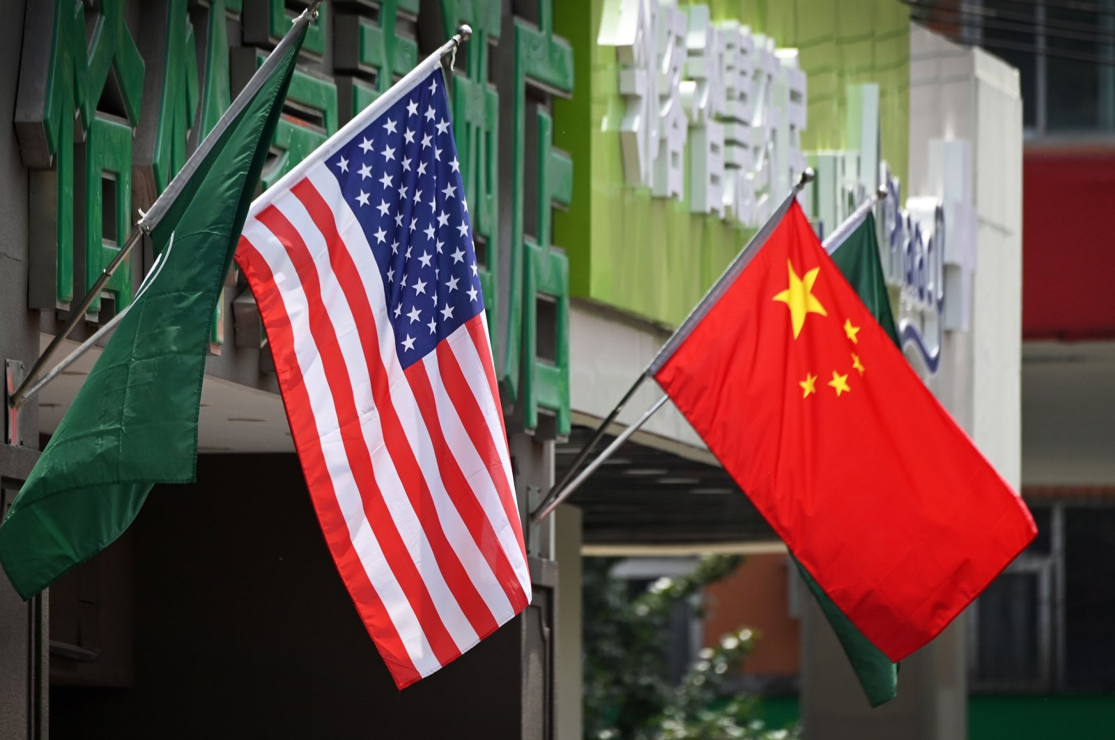 This file photo taken on May 14, 2019 shows the US (L) and Chinese flags displayed outside a hotel in Beijing. (AFP Photo)