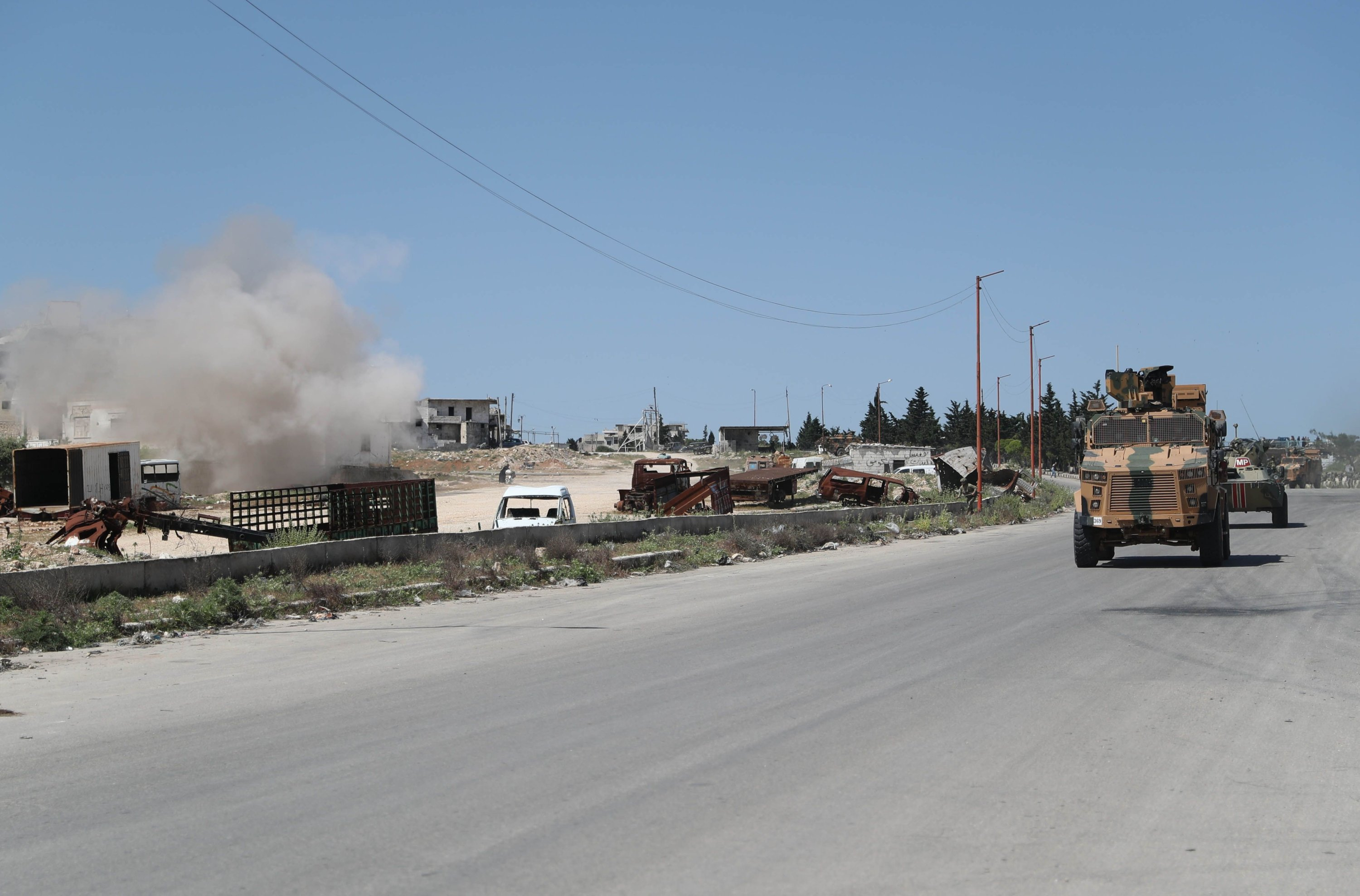 Vehicles in a joint Turkish-Russian military patrol drive along the M4 highway, which links the northern Syrian provinces of Aleppo and Latakia, near Ariha in Syria's northwestern Idlib province, May 12, 2020. (AFP)