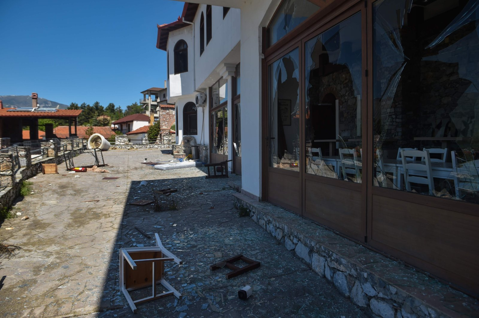 View of the damage on May 8, 2020, caused by some 250 protestors who ransacked a hotel to prevent the settlement of 57 refugee families on May 4, in the village of Arnissa, 560km north from Athens. (AFP Photo)