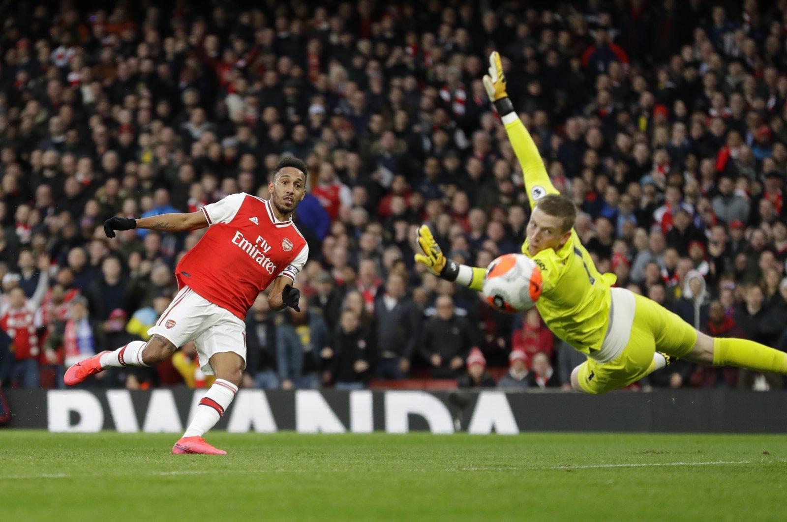 Arsenal's Pierre-Emerick Aubameyang scores a a goal during a Premier League against Everton in London, Feb. 23, 2020. (AP Photo)