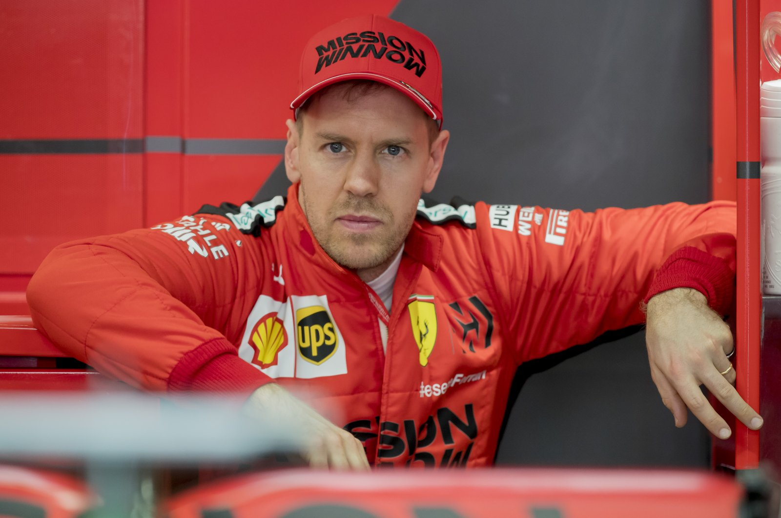 Sebastian Vettel stands at his box during the Formula One preseason testing session at the Barcelona Catalunya racetrack in Montmelo, outside Barcelona, Spain, Feb. 21, 2020. (AP Photo)