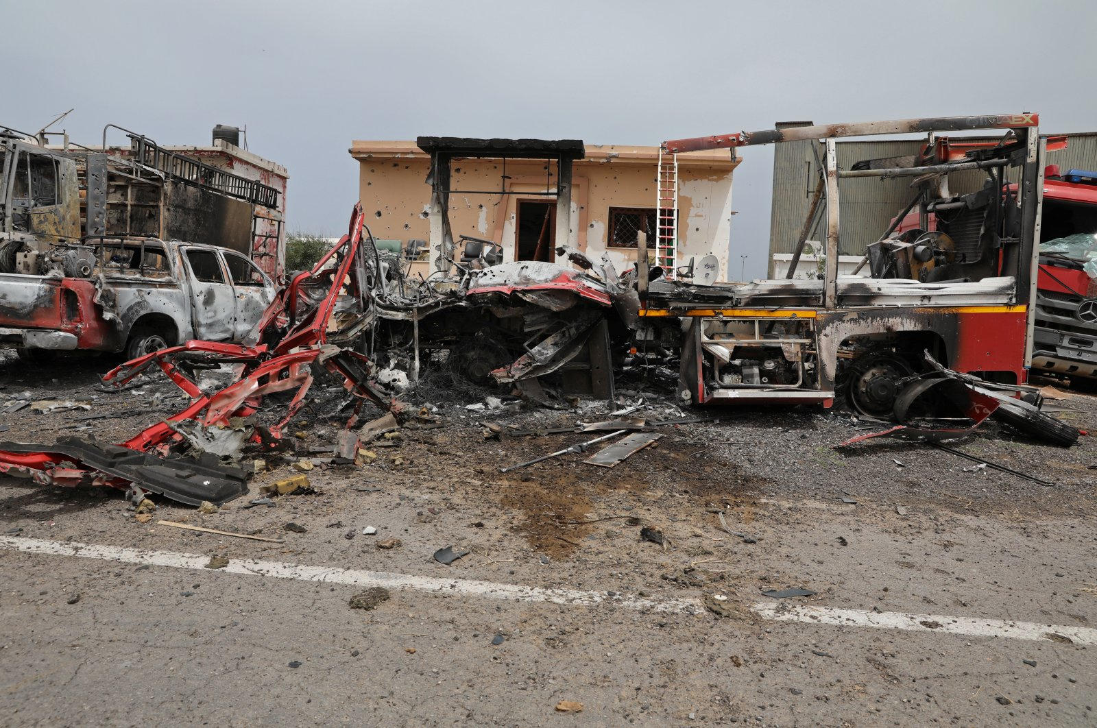 Damaged vehicles are seen at Tripoli's Mitiga airport after it was hit by shelling in Tripoli, Libya, May 10, 2020. (REUTERS Photo)