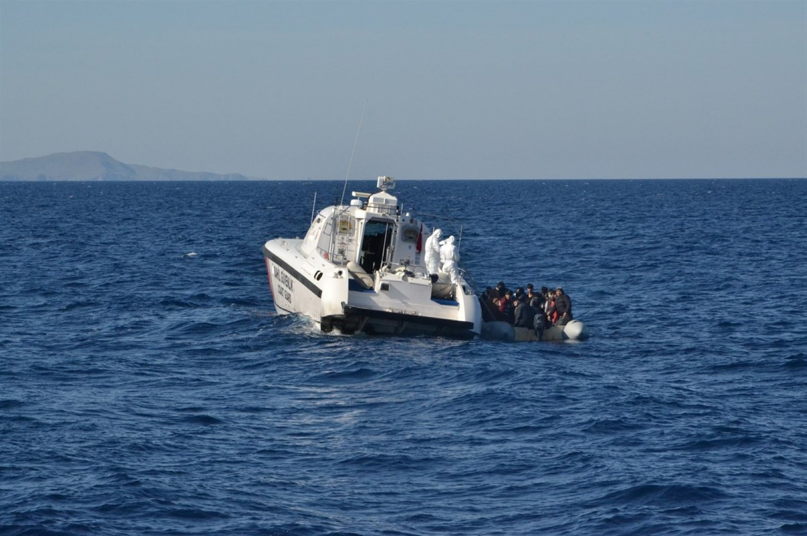 The Turkish coast guard saved the 24 migrants, from Afghanistan, Congo, Central African Republic and Mali, traveling in a rubber boat and provided them with food and clothing, Çanakkale, May 11, 2020. (IHA)