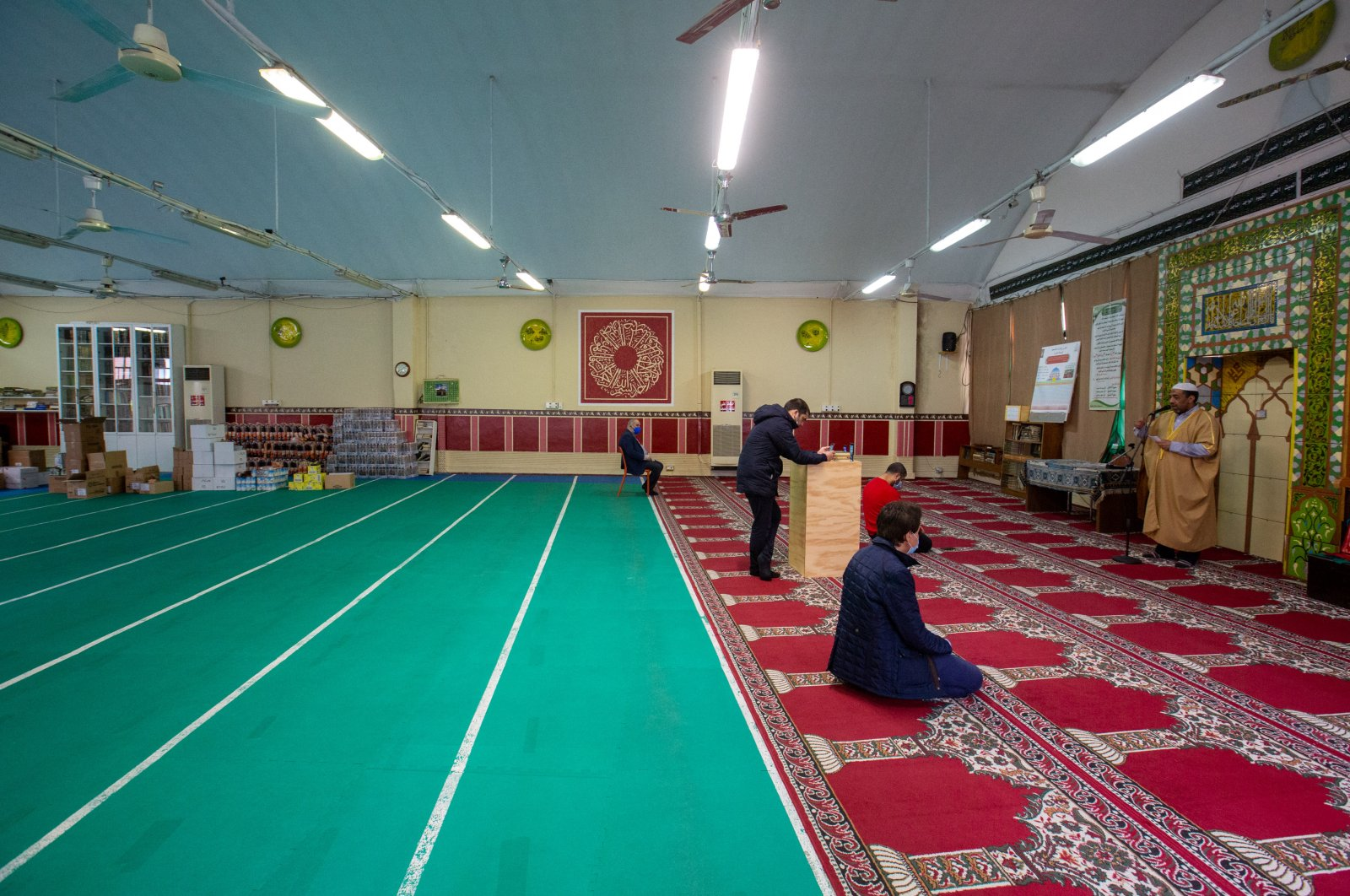 Muslims pictured in a practically empty mosque due to coronavirus restrictions, Milan, Italy, May 1, 2020. (Reuters Photo)