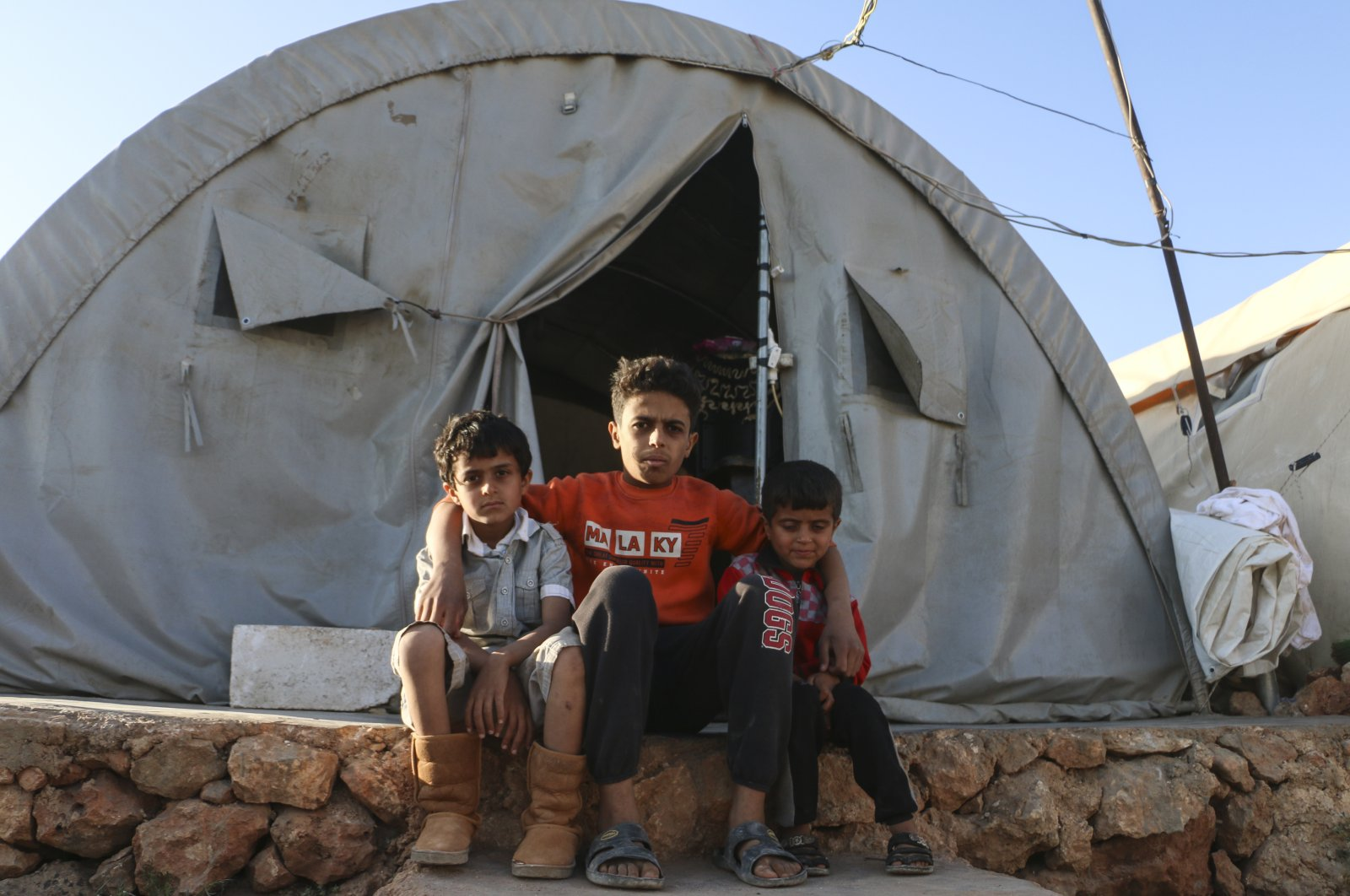 Mohammad, 14, who lost his parents in a bombing attack conducted by the Assad regime during Ramadan, has sought refuge with survivors in a tent camp pictured in this undated photo, in Idlib, Syria. (AA Photo)