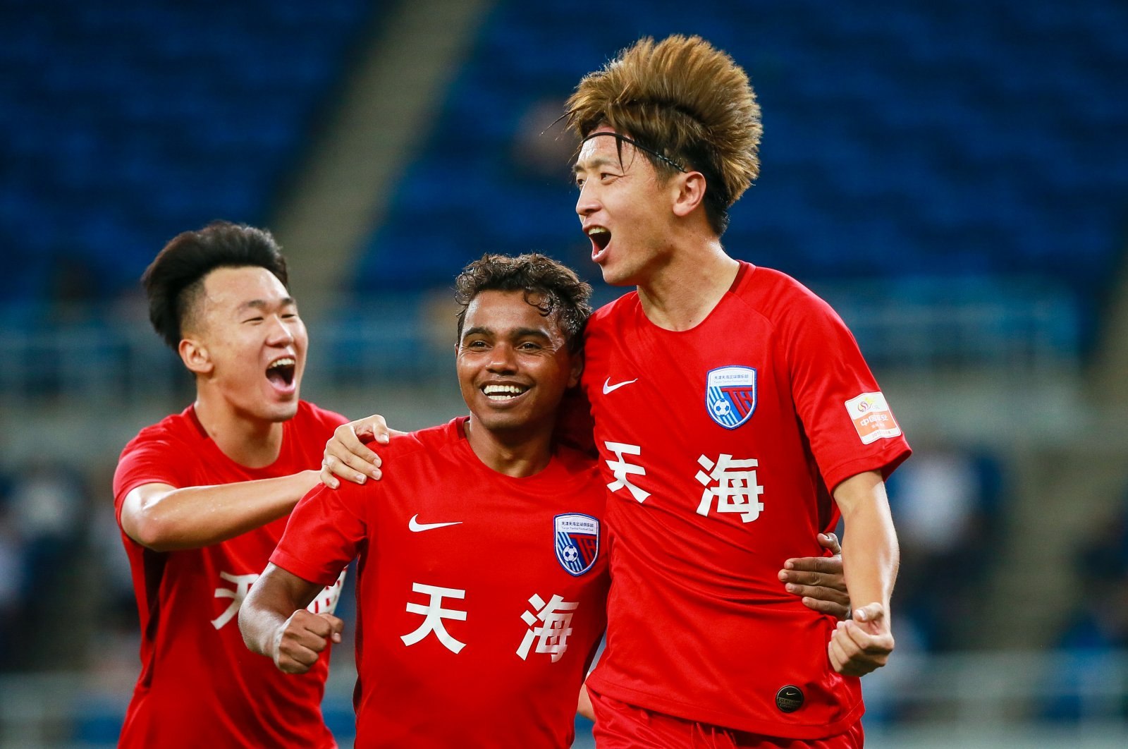 Tianjin Tianhai F.C players celebrate a goal at the 22nd round match of the 2019 Chinese Football Association Super League (CSL) in Tianjin, China, Aug. 15, 2019. (Reuters Photo)