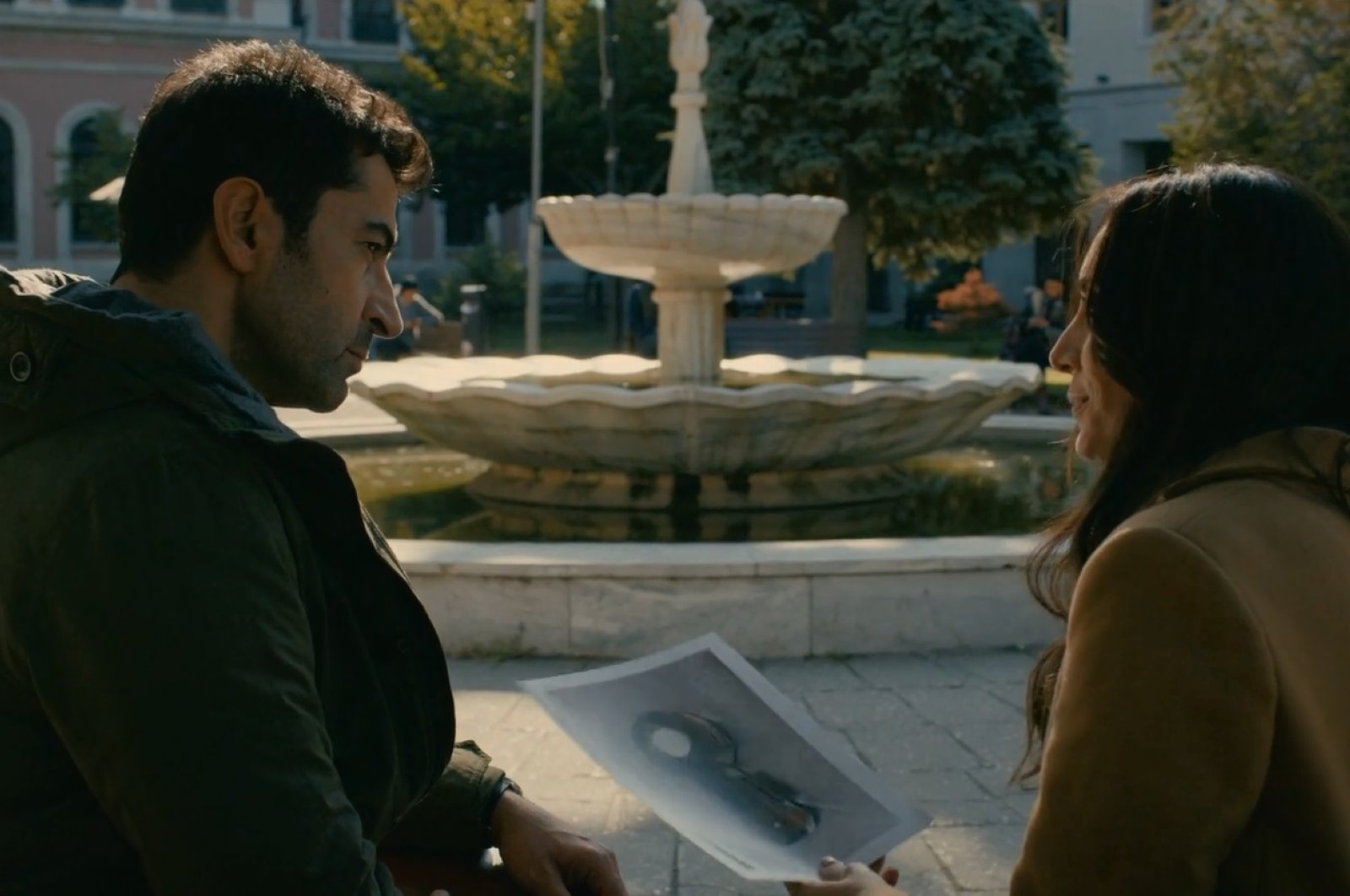 """In this scene from """"Alef,"""" Yaşar Turan (R) tells about antique dervish mirror and Qalandars to detective Kemal."""