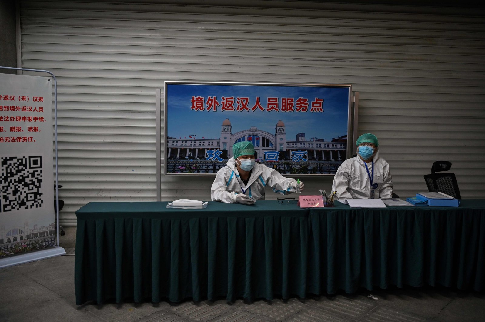 Employees wearing protective gear work at Hankou railway station, Wuhan, China, May 12, 2020. (AFP Photo)