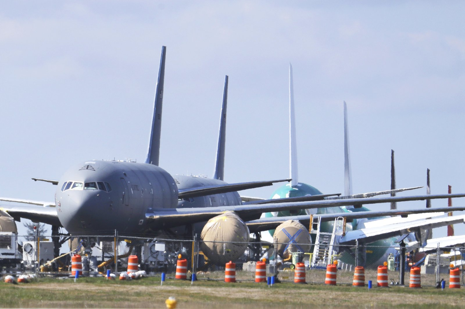 In this April 7, 2020, file photo, U.S. Air Force KC-46 tankers being built by Boeing sit parked at the Paine Field airport in Everett, Wash. (AP Photo)
