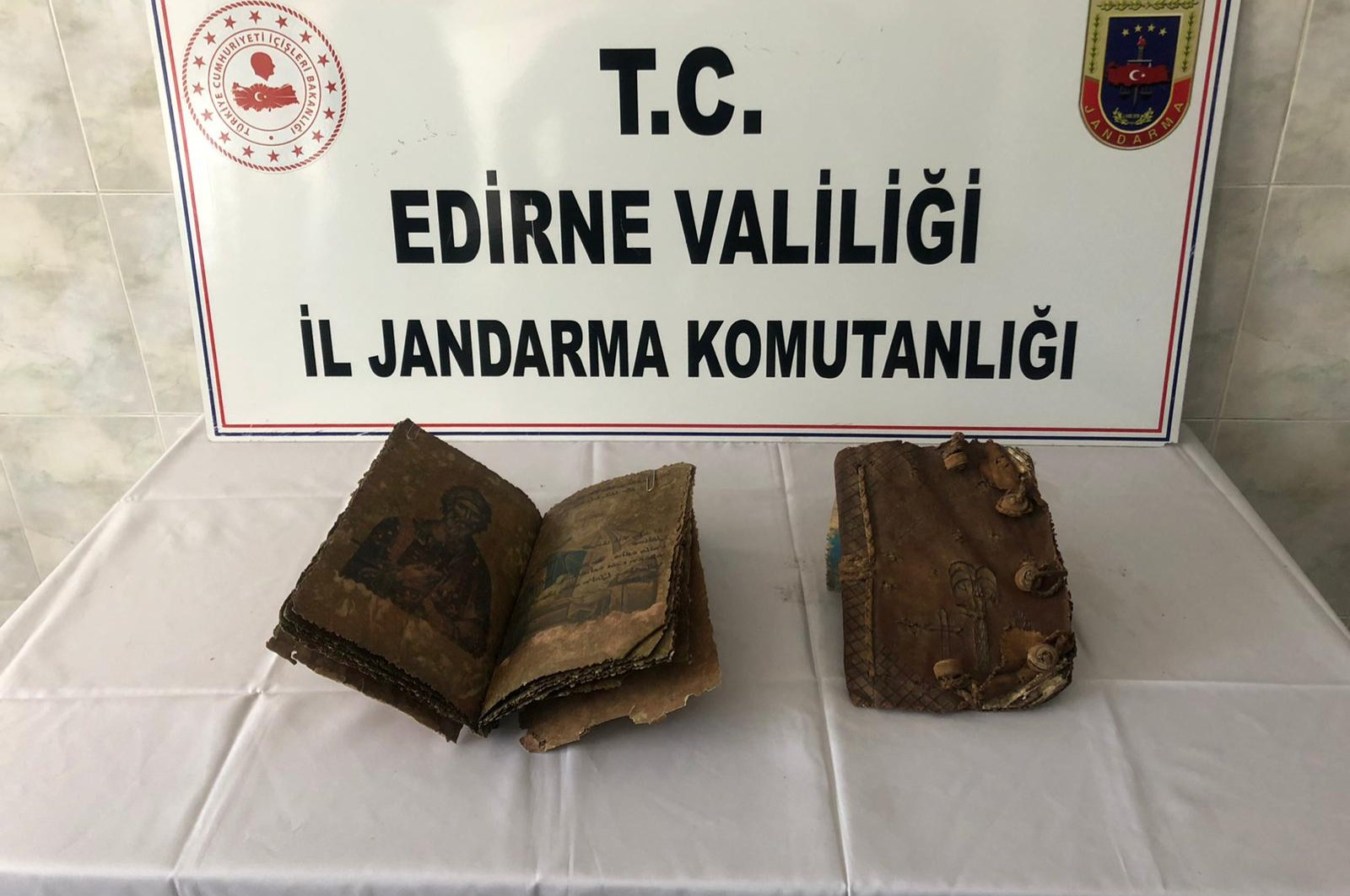 Two handwritten Bibles believed to be 500-year-old seen at the Edirne provincial gendarmerie command, May 12, 2020. (AA Photo)