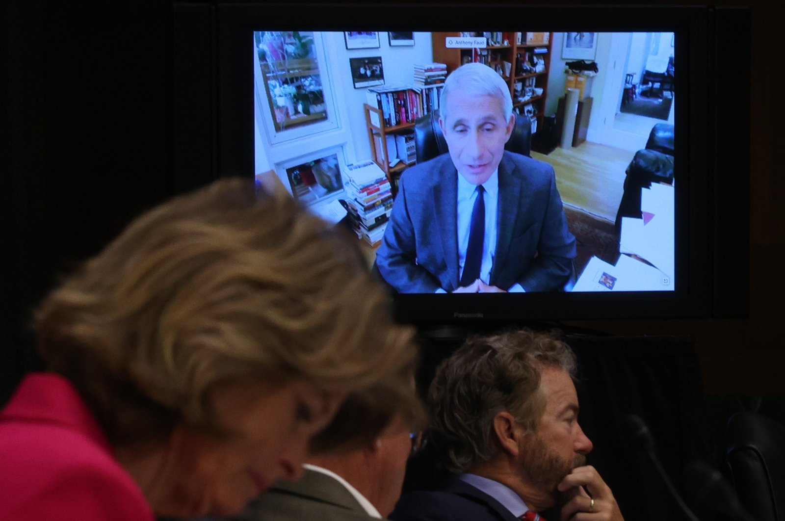 Senators listen to Dr. Anthony Fauci, director of the National Institute of Allergy and Infectious Diseases speak remotely during a Senate committee meeting, Washington, May 12, 2020. (AFP Photo)