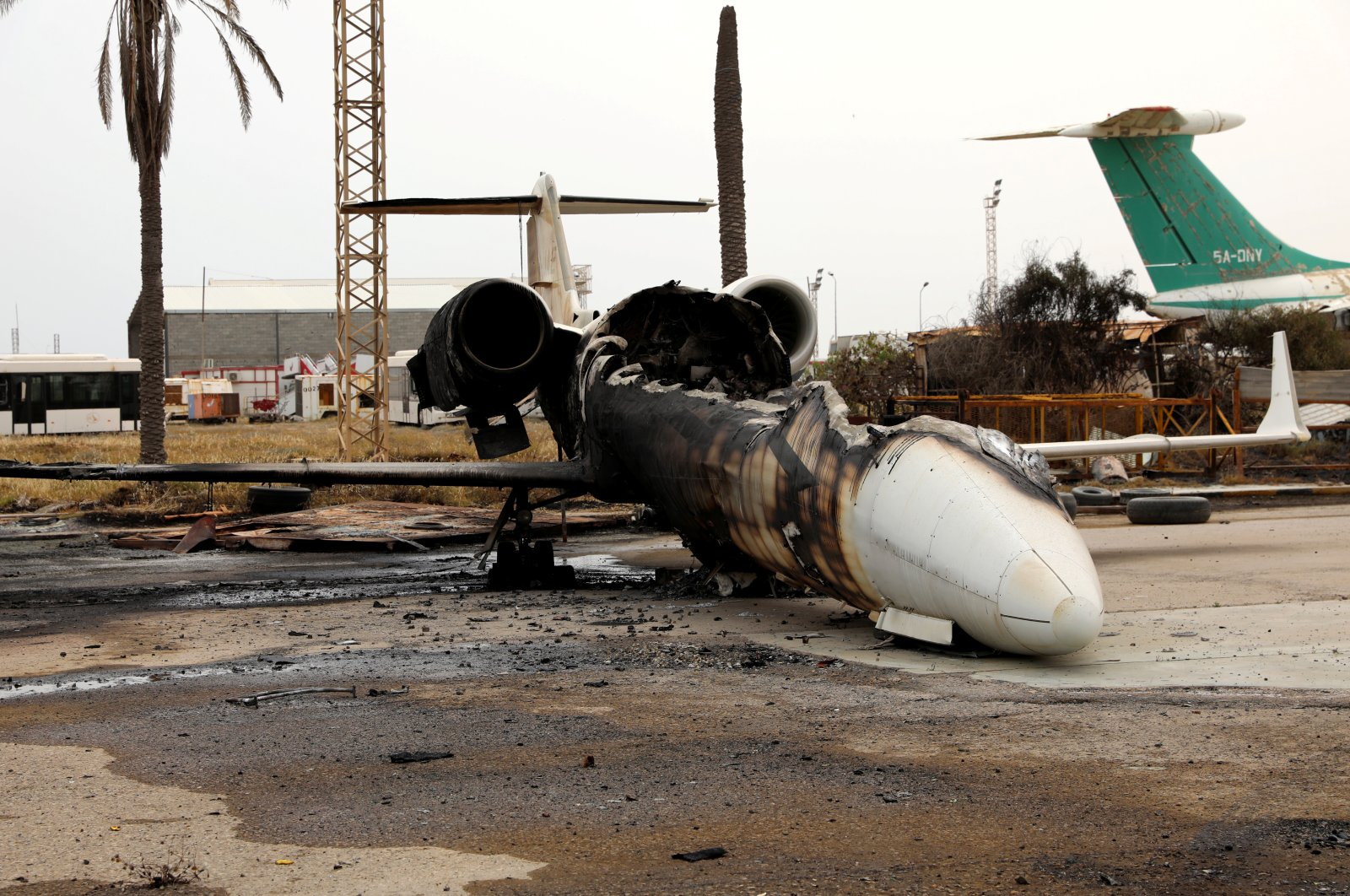 A passenger plane damaged by Haftar shelling seen at Mitiga airport Tripoli, Libya, May 10, 2020. (Reuters Photo)