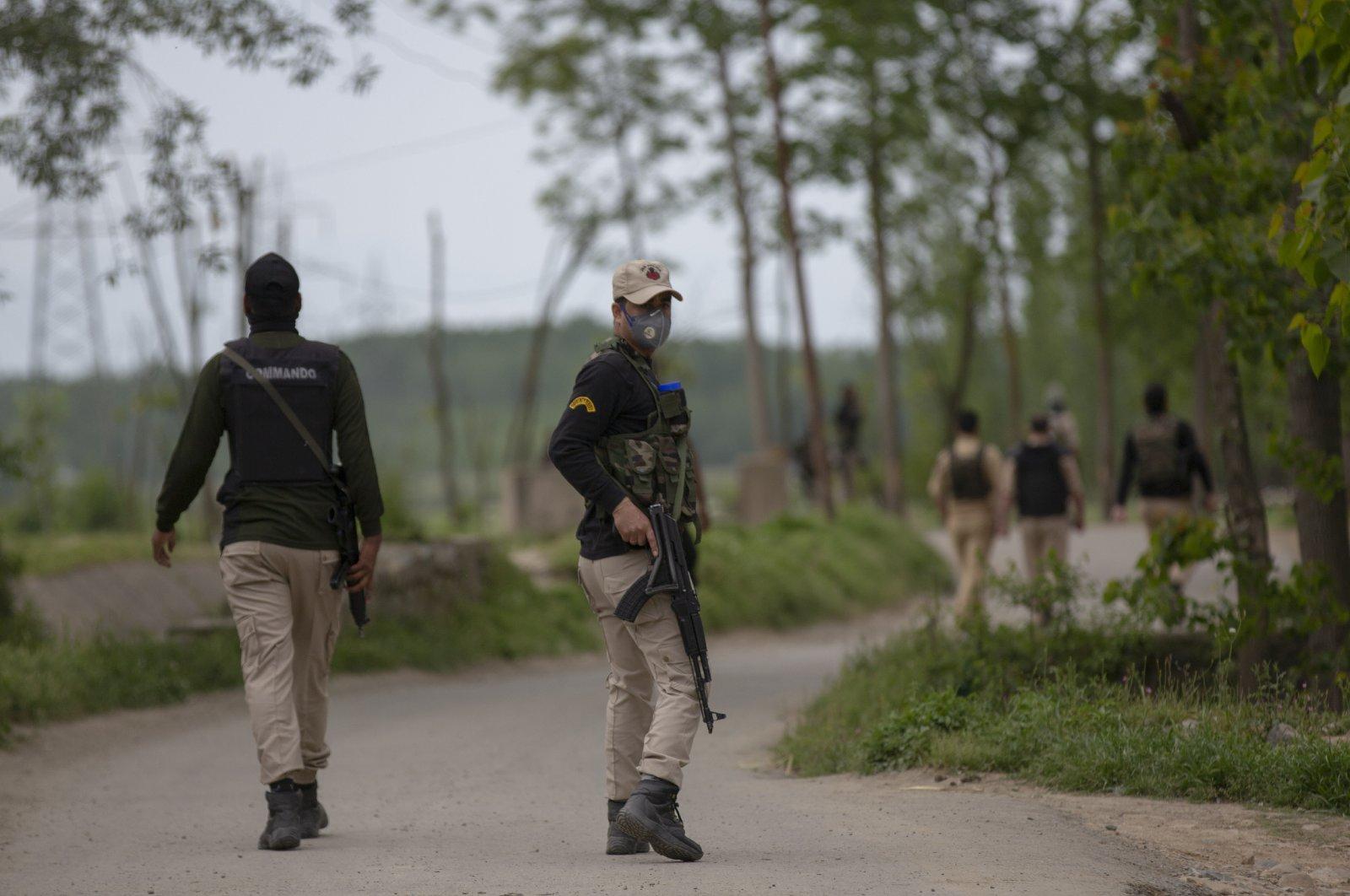 Indian policemen patrol the Awantipora area, south of Srinagar, Indian-controlled Kashmir, May 6, 2020. (AP Photo)