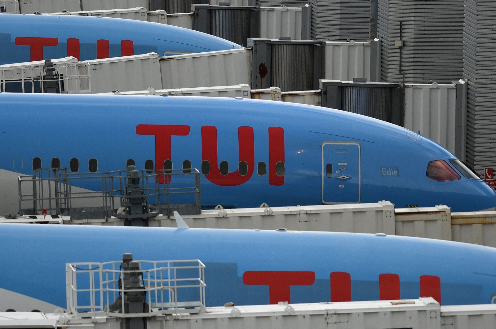Aircraft operated by German tourism company TUI grounded due to the COVID-19 pandemic on the apron at Manchester Airport in Manchester, north west England, May 1, 2020. (AFP Photo)