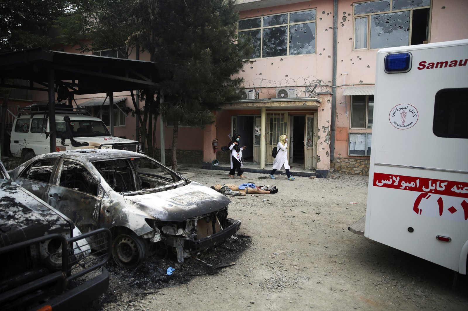A body of a militant killed during an attack lies on the ground at a maternity hospital in Kabul, Afghanistan, Tuesday, May 12, 2020. (AP Photo)