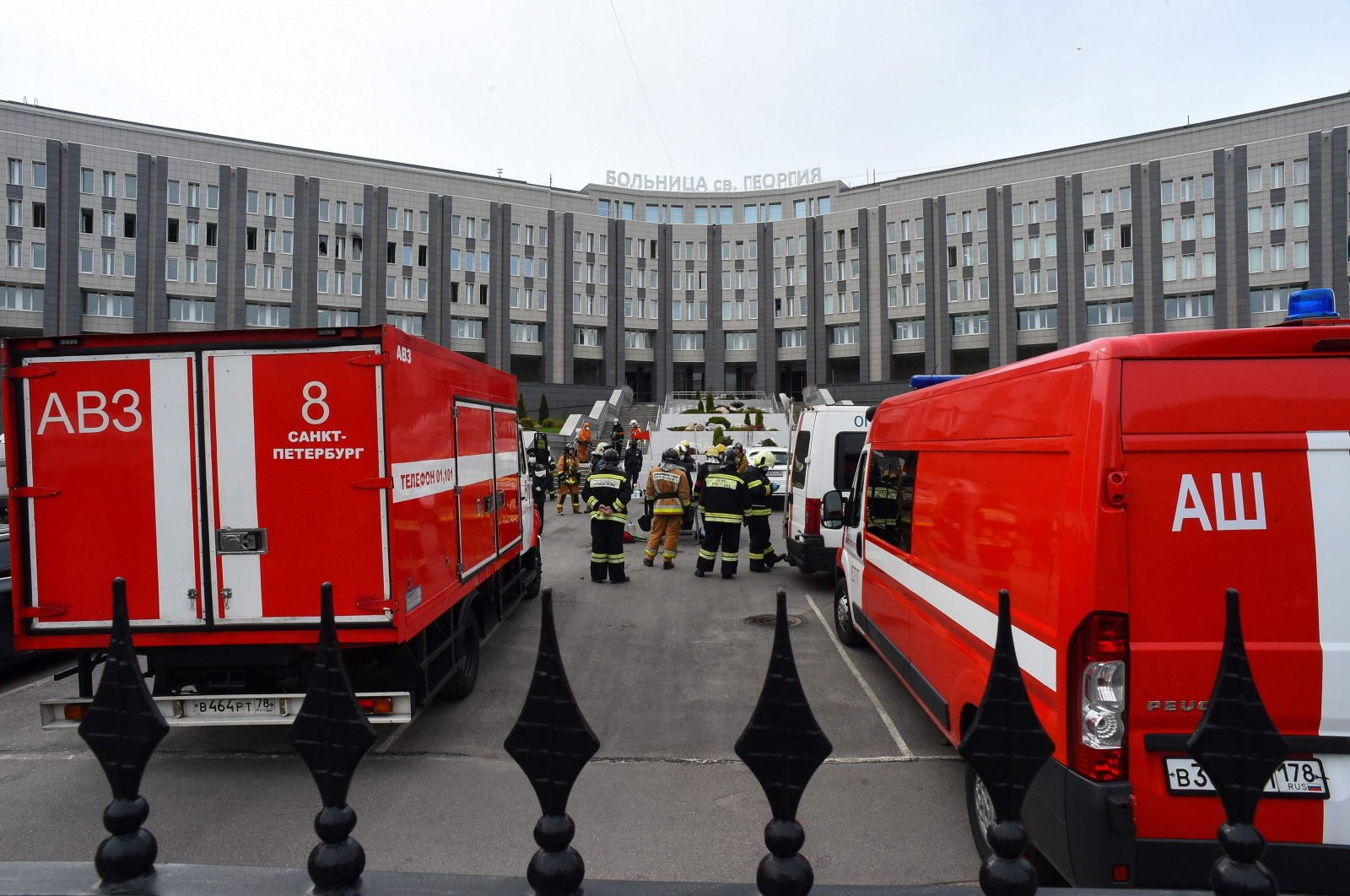 Emergencies personnel work at the site of a fire at the St. George hospital in St. Petersburg, Russia, May 12, 2020. (AFP Photo)