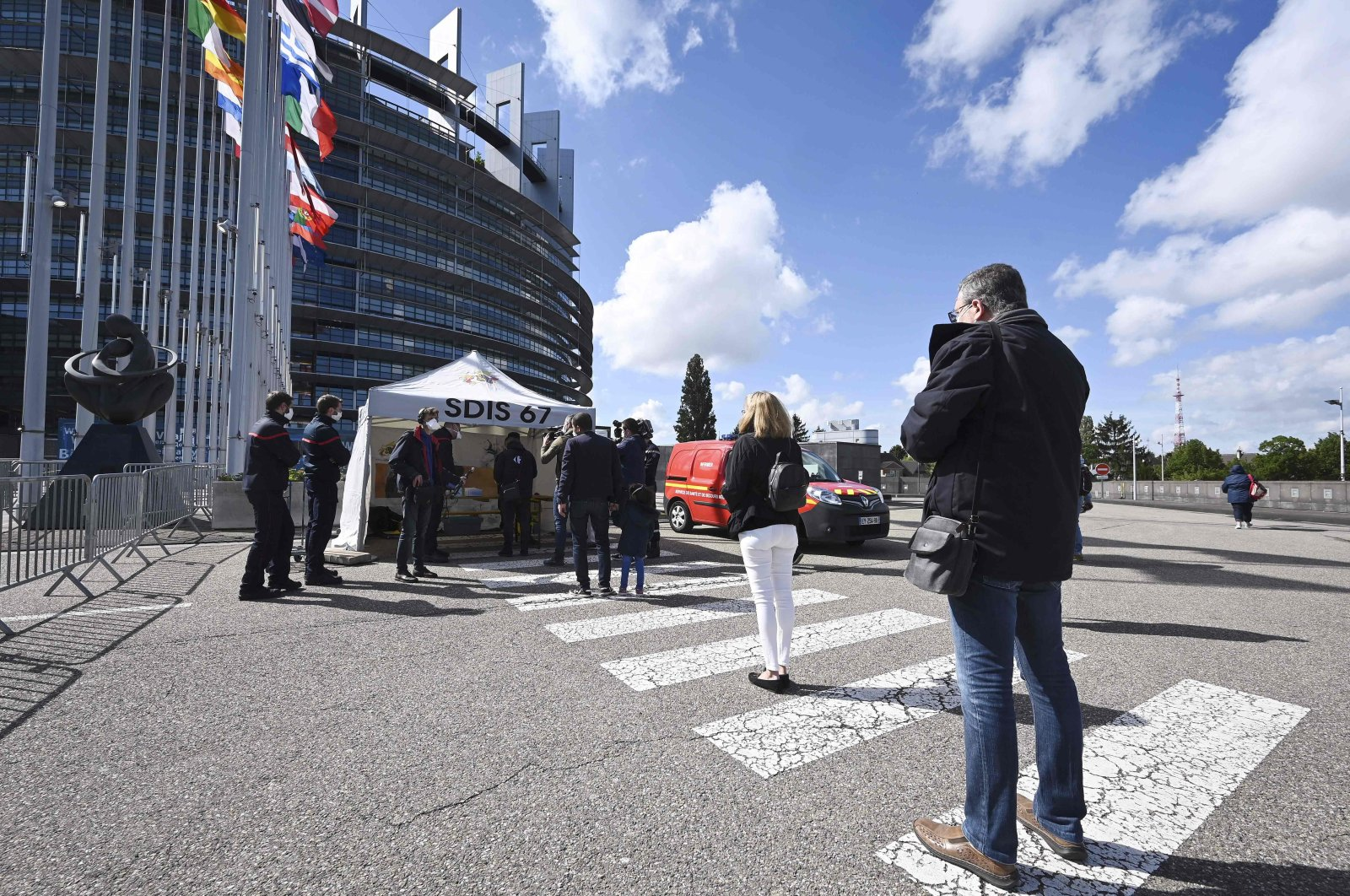 People queue at the entrance of a COVID-19 testing center set up at the European Parliament, Strasbourg, eastern France, May 12, 2020. (AFP Photo)