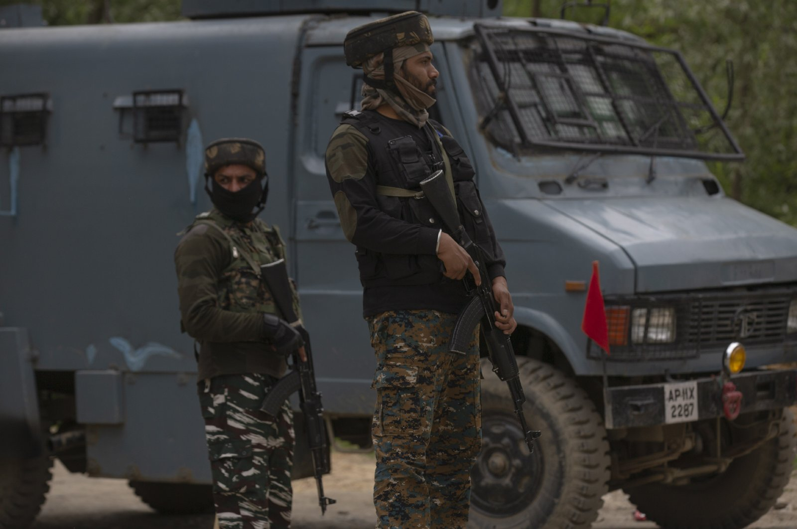 Indian paramilitary soldiers stand guard as police and army soldiers launch an operation in Awantipora area, south of Srinagar, Indian controlled Kashmir, Wednesday, May 6, 2020. (AP Photo)