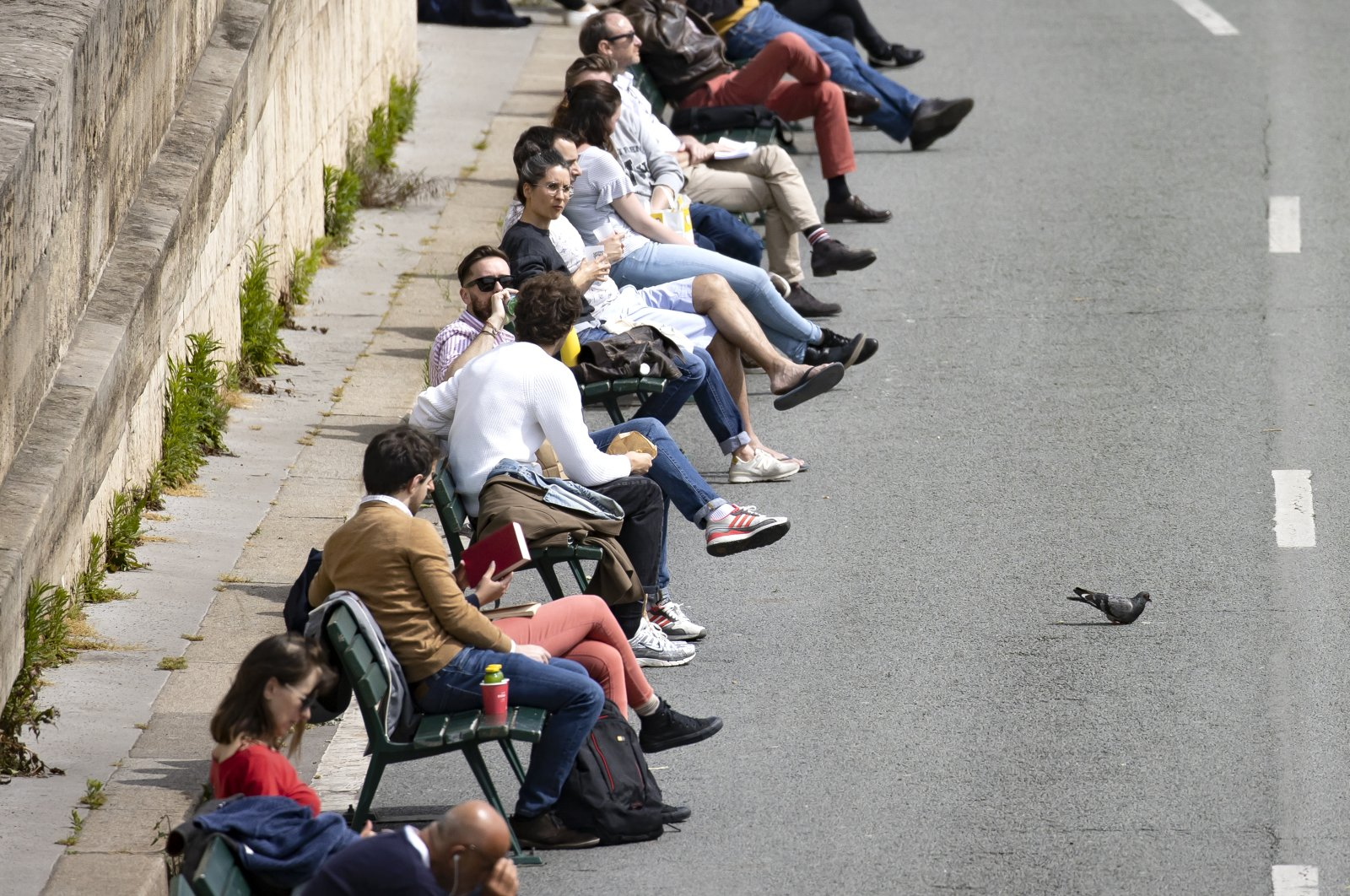 Parisians enjoy the sun on the Seine river bank which reopened to the public, Paris, May 12, 2020. (EPA Photo)