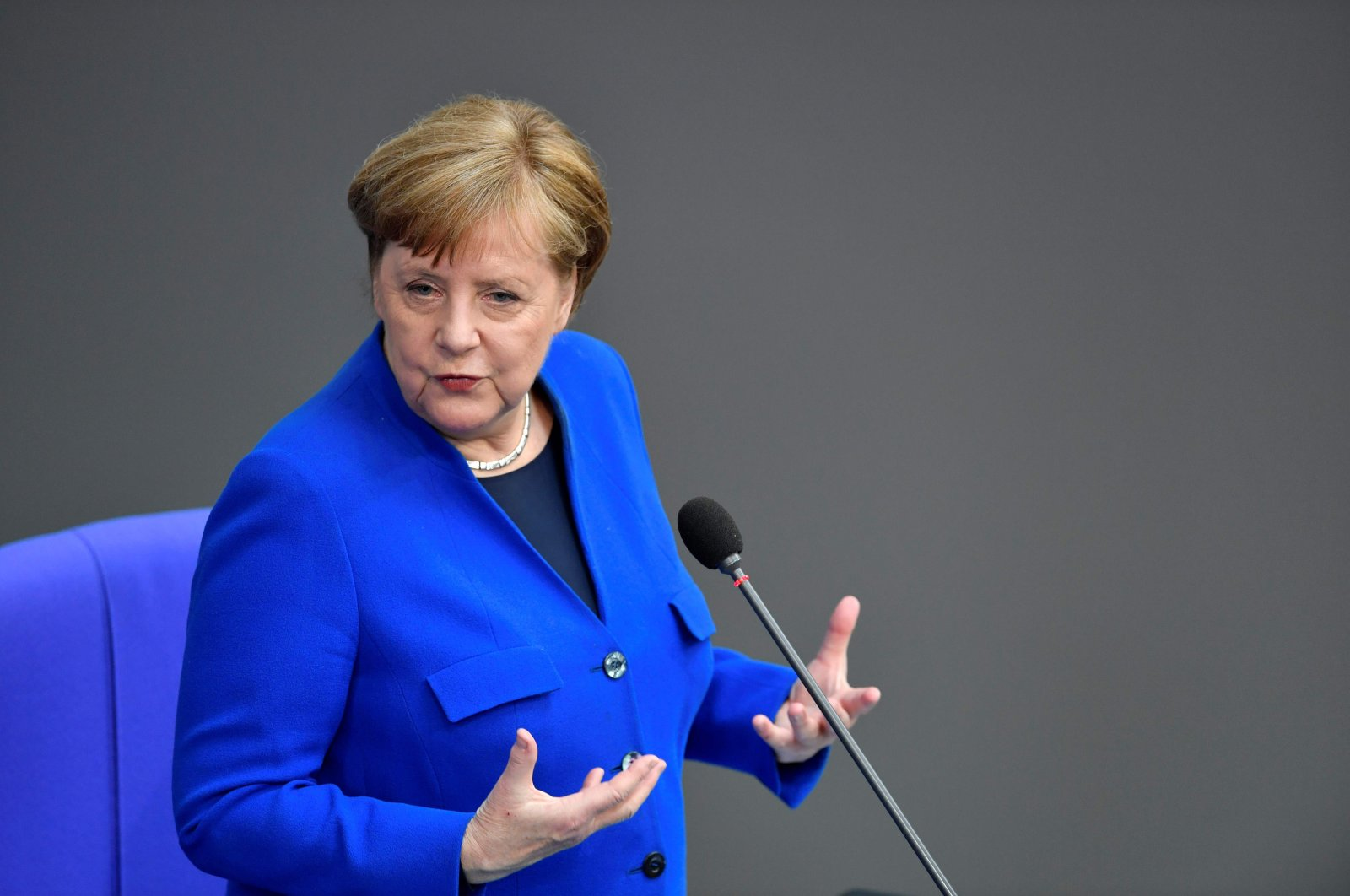 German Chancellor Angela Merkel speaks as she answers questions of parliament members at the Bundestag, the lower house of Parliament, Berlin, Germany, May 13, 2020. (AFP Photo)
