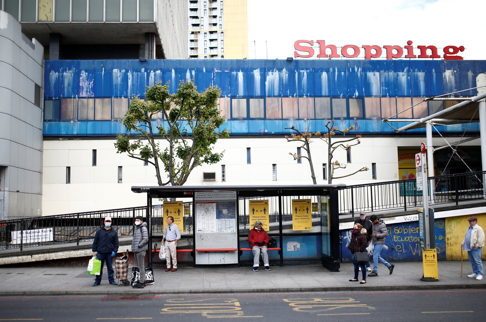 People wait at a bus stop, London, Britain, May 13, 2020. (Reuters Photo)
