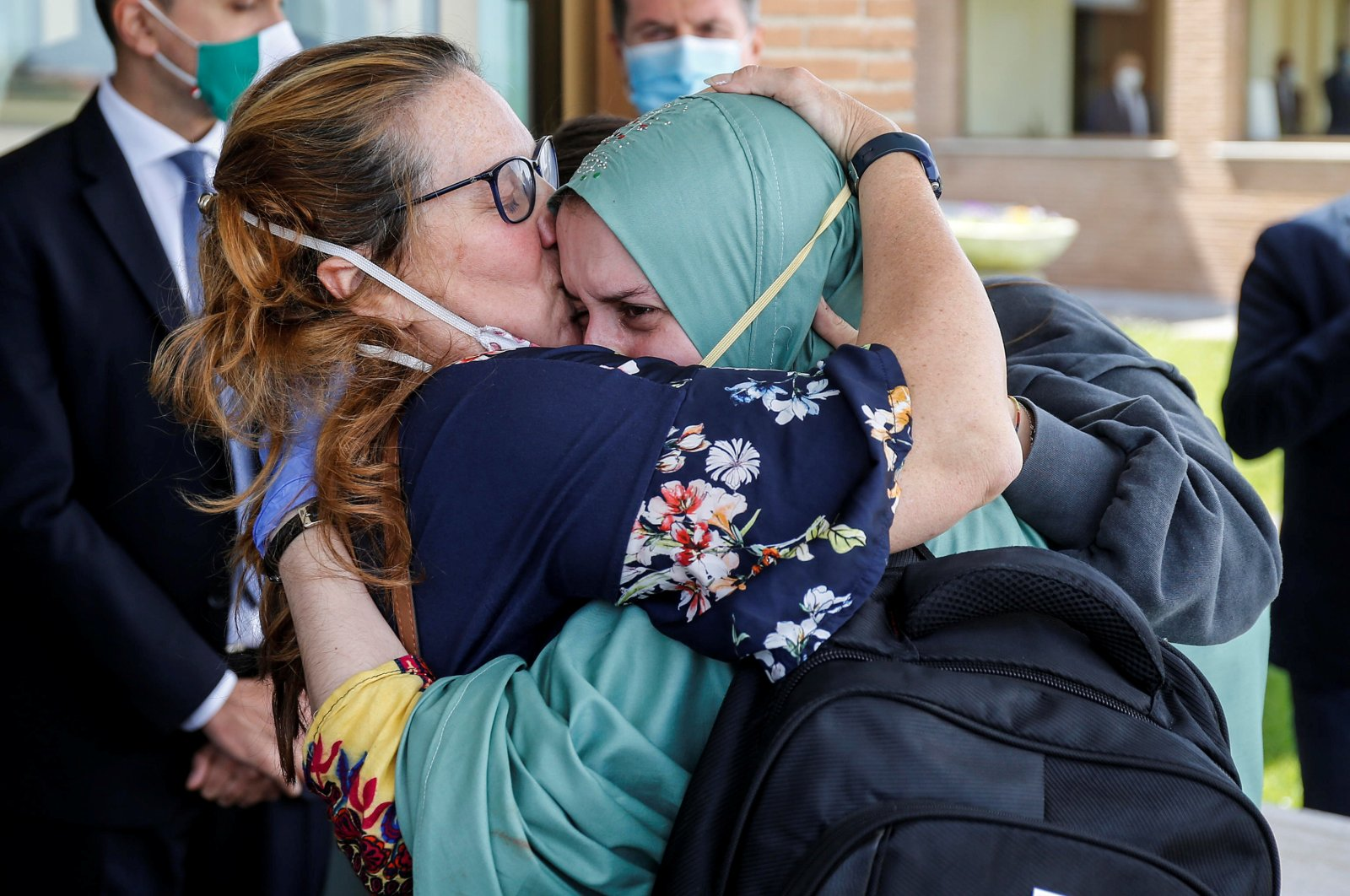 Silvia Romano, an Italian aid worker who was kidnapped by gunmen in Kenya 18 months ago, is kissed by her mother, Francesca Fumagalli, at Ciampino military airport in Rome, Italy, May 10, 2020. (Reuters Photo)