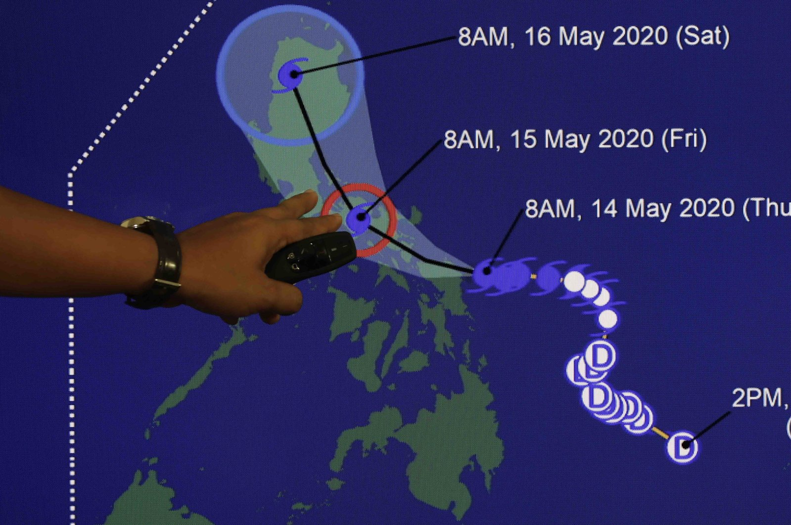 Weather forecaster Christopher Perez points to a projected track of Typhoon Vongfong during a briefing at the Philippine Atmospheric Geophysical and Astronomical Services Administration (PAGASA) headquarters, Quezon City, Metro Manila, Philippines, May 14, 2020. (EPA Photo)