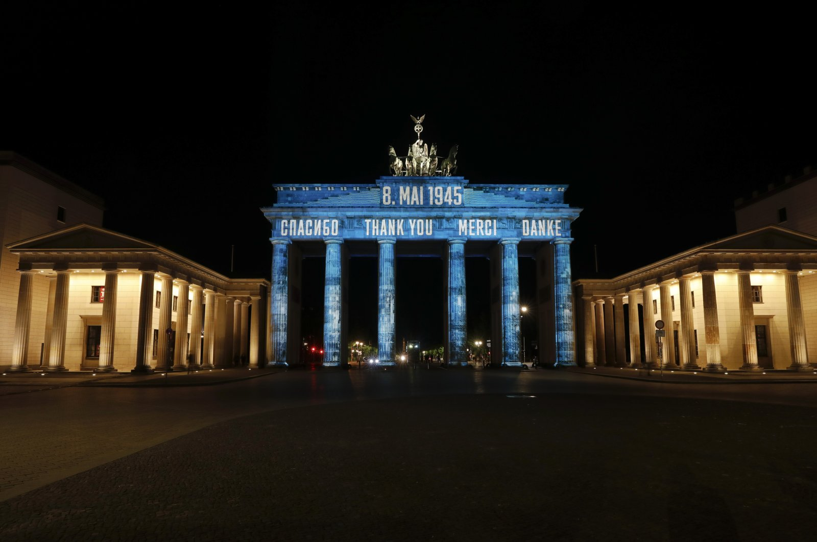 The German landmark Brandenburg Gate is illuminated to mark the 75th anniversary of Victory Day and the end of World War II in Europe, Berlin, Germany, May 8, 2020. (AP Photo)