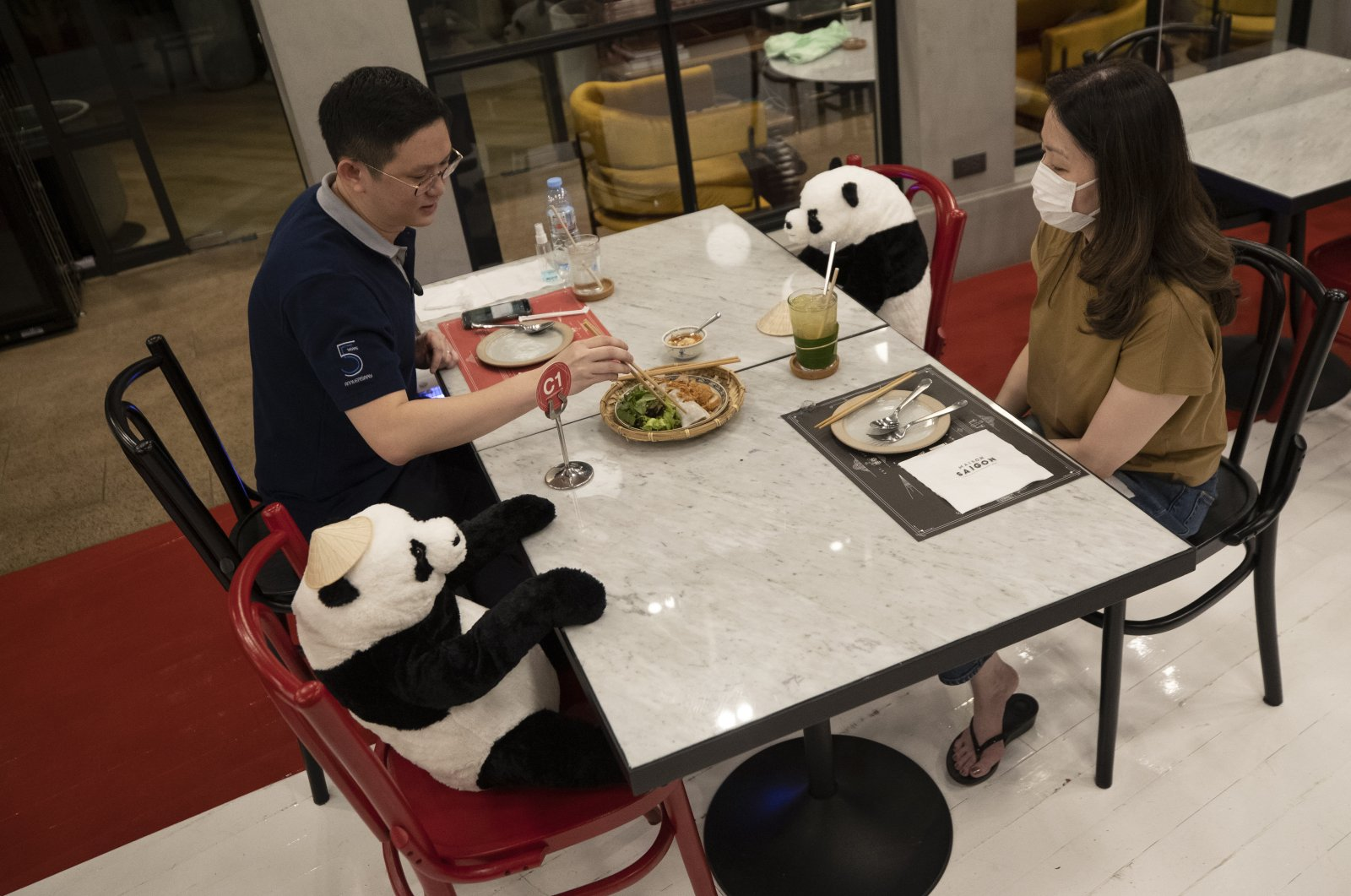 Customers of the Maison Saigon restaurant sit next to stuffed panda dolls the restaurant uses as space keepers for social distancing to help curb the spread of the coronavirus in Bangkok, Thailand, May 5, 2020. (AP Photo)