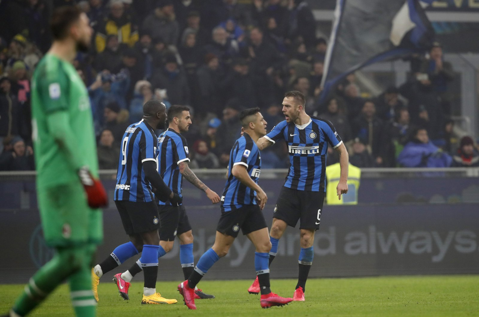 Inter Milan players celebrate a goal during a Serie A match against AC Milan, in Milan, Italy, Feb. 9, 2020. (AP Photo)