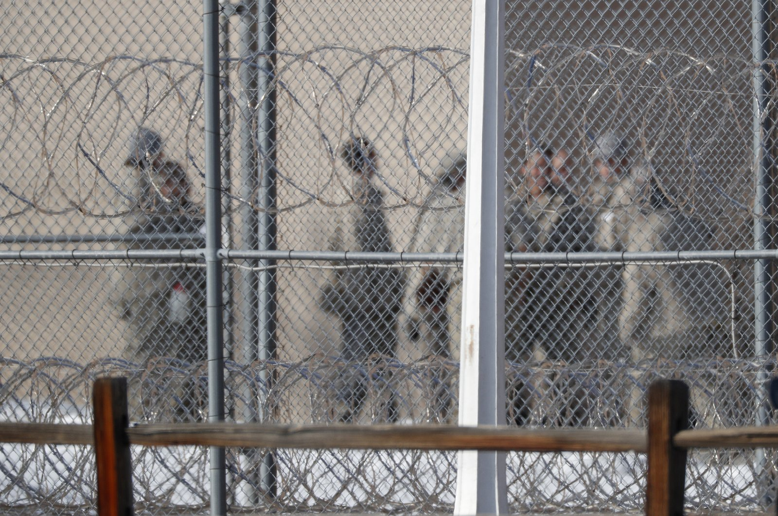 Prisoners stand outside a federal correctional institution in Englewood, Colorado, U.S. Feb. 18, 2020. (AP Photo)