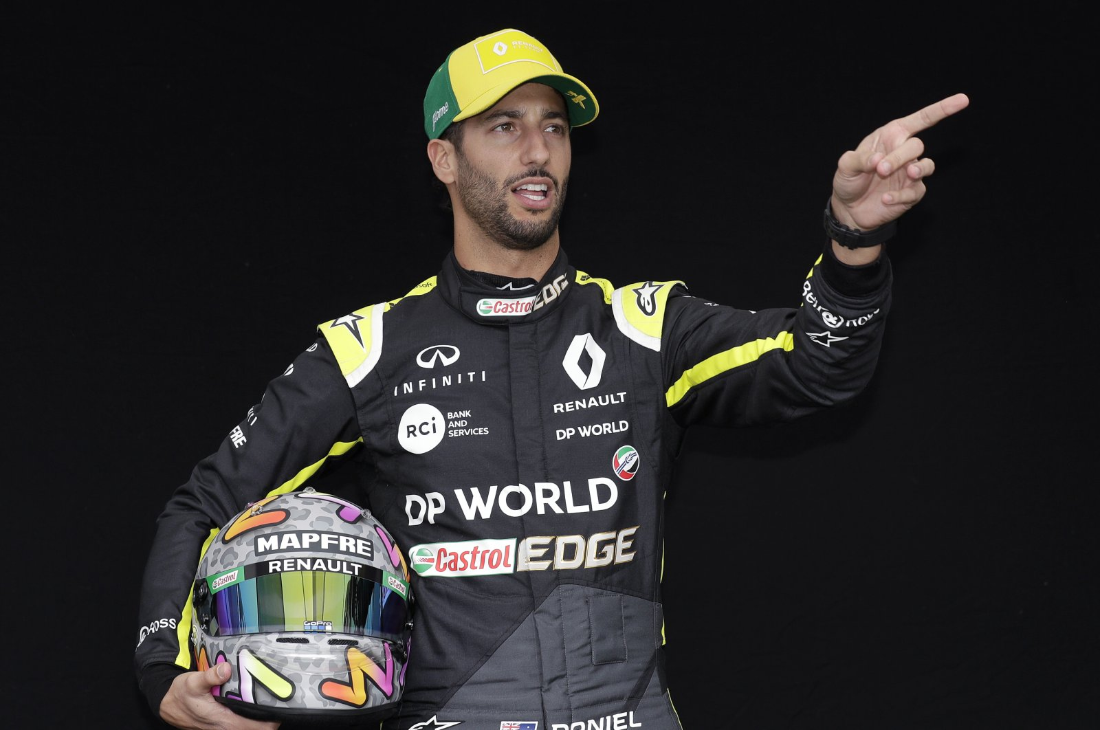 Daniel Ricciardo poses for a photo at the Australian GP in Melbourne, March 12, 2020. (AP Photo)