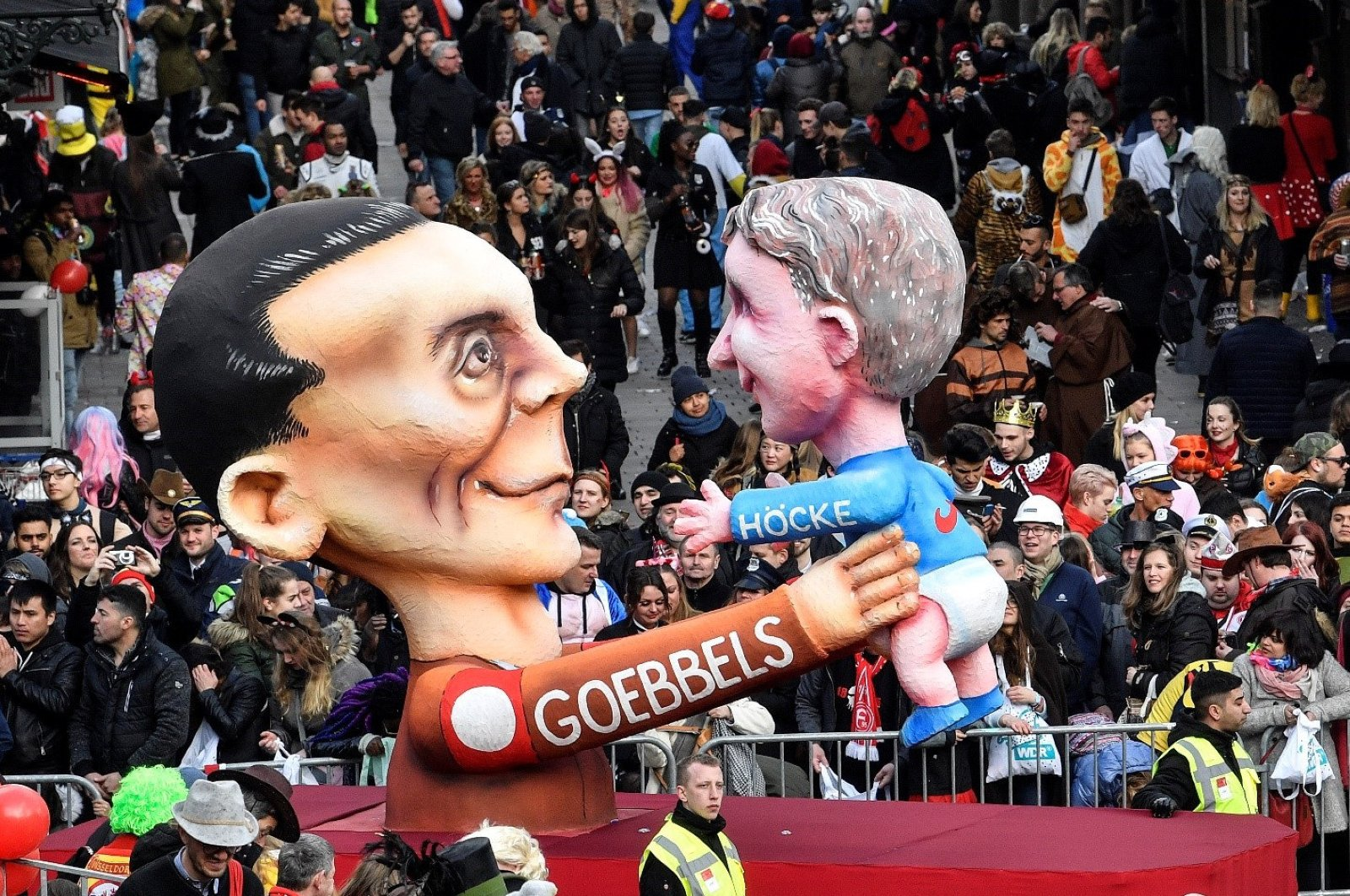 A carnival float depicts Nazi propaganda minister Joseph Goebbels holding AfD right-wing politician Bjoern Hoecke during the traditional carnival parade in Duesseldorf, Germany, March 4, 2019. (AP Photo)