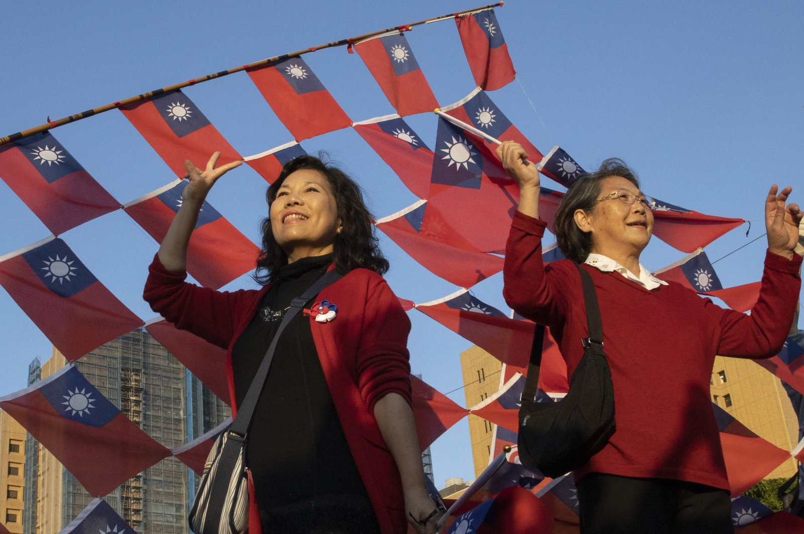 Supporters of the Nationalist or KMT party pose with the Taiwanese flag during a rally for the presidential election in Taipei, Taiwan, Jan. 9, 2020. (AP Photo)