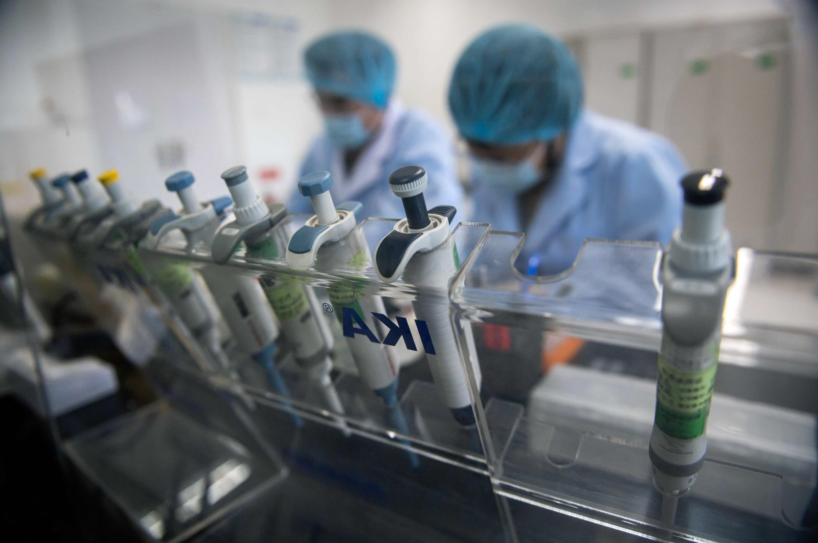 Workers are seen inside the Beijing Applied Biological Technologies (XABT) research and development laboratory, Beijing, May 14, 2020. (AFP Photo)