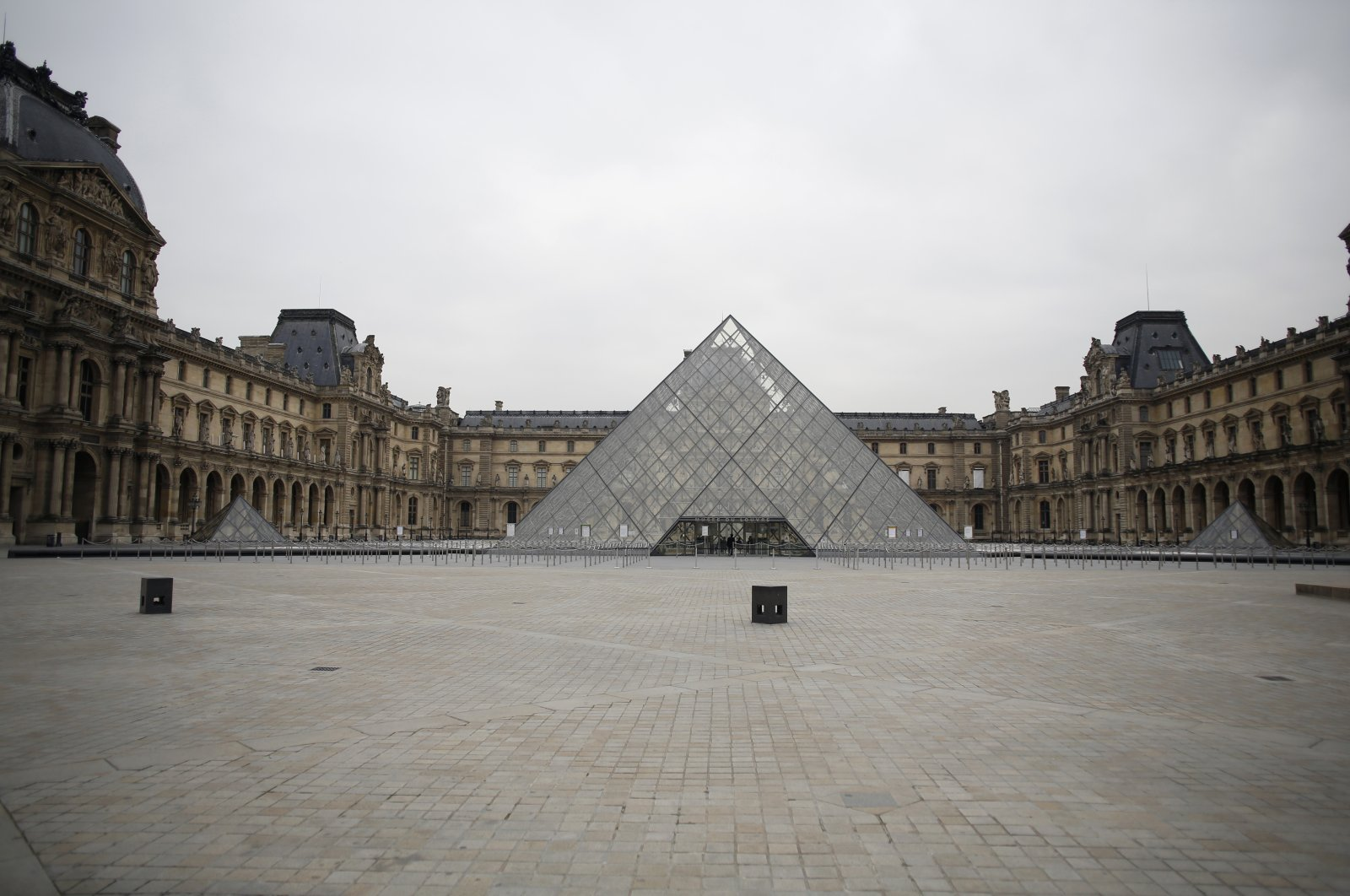 The empty courtyard of the Louvre Museum is seen in Paris, France, March 17, 2020. (AP Photo)