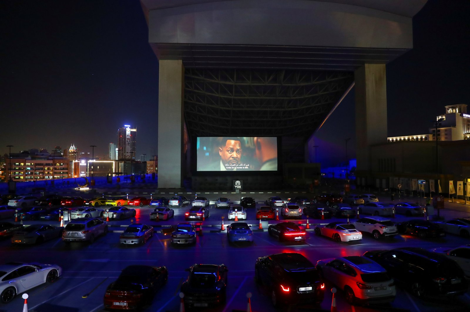 People sit in their cars watching a movie in a drive-in cinema at the Mall of the Emirates during the COVID-19 outbreak, in Dubai, the United Arab Emirates, May 13, 2020. (REUTERS Photo)