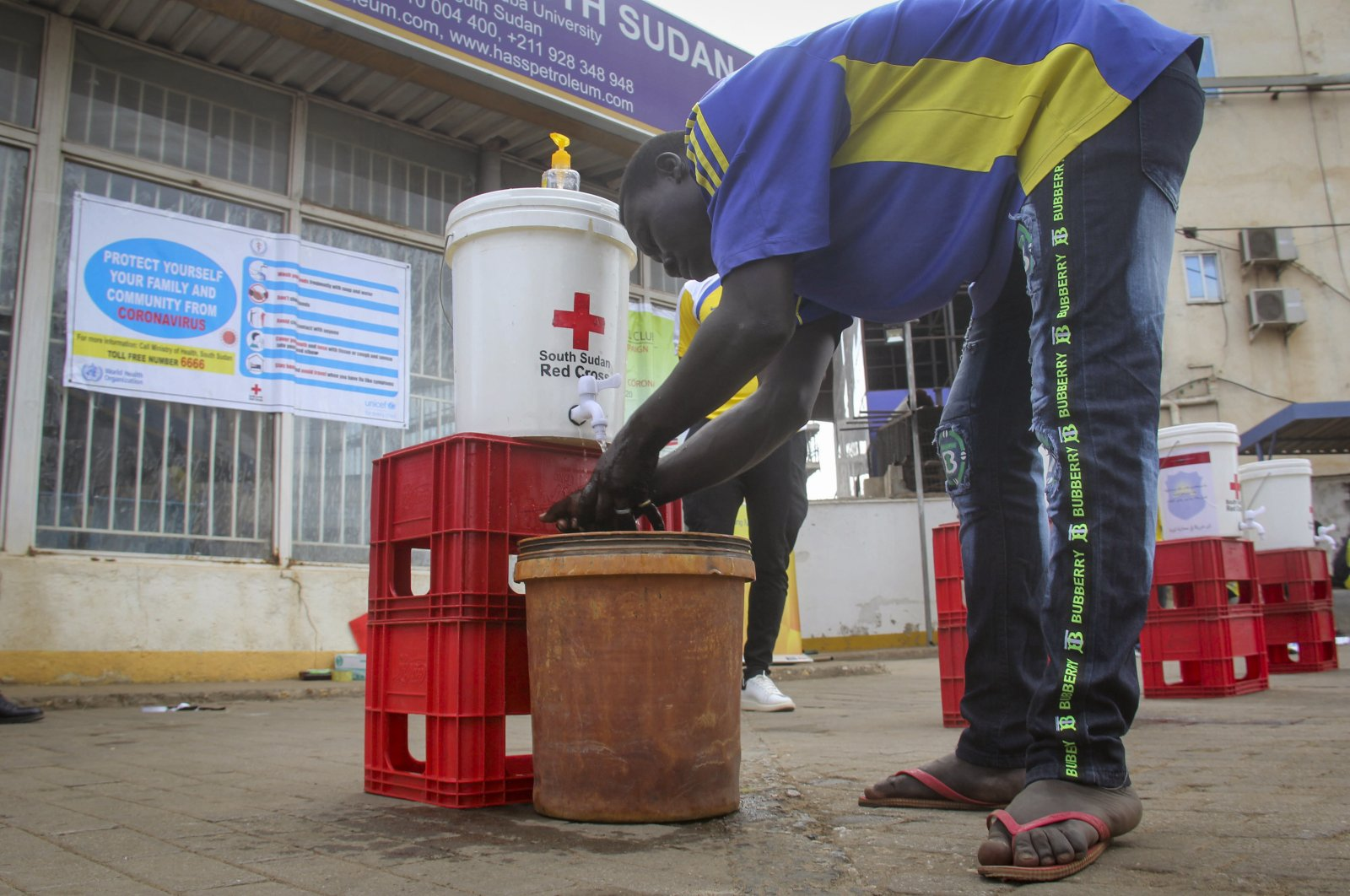 A man washes his hands to curb the spread of the new coronavirus, Juba, South Sudan, April 6, 2020. (AP Photo)